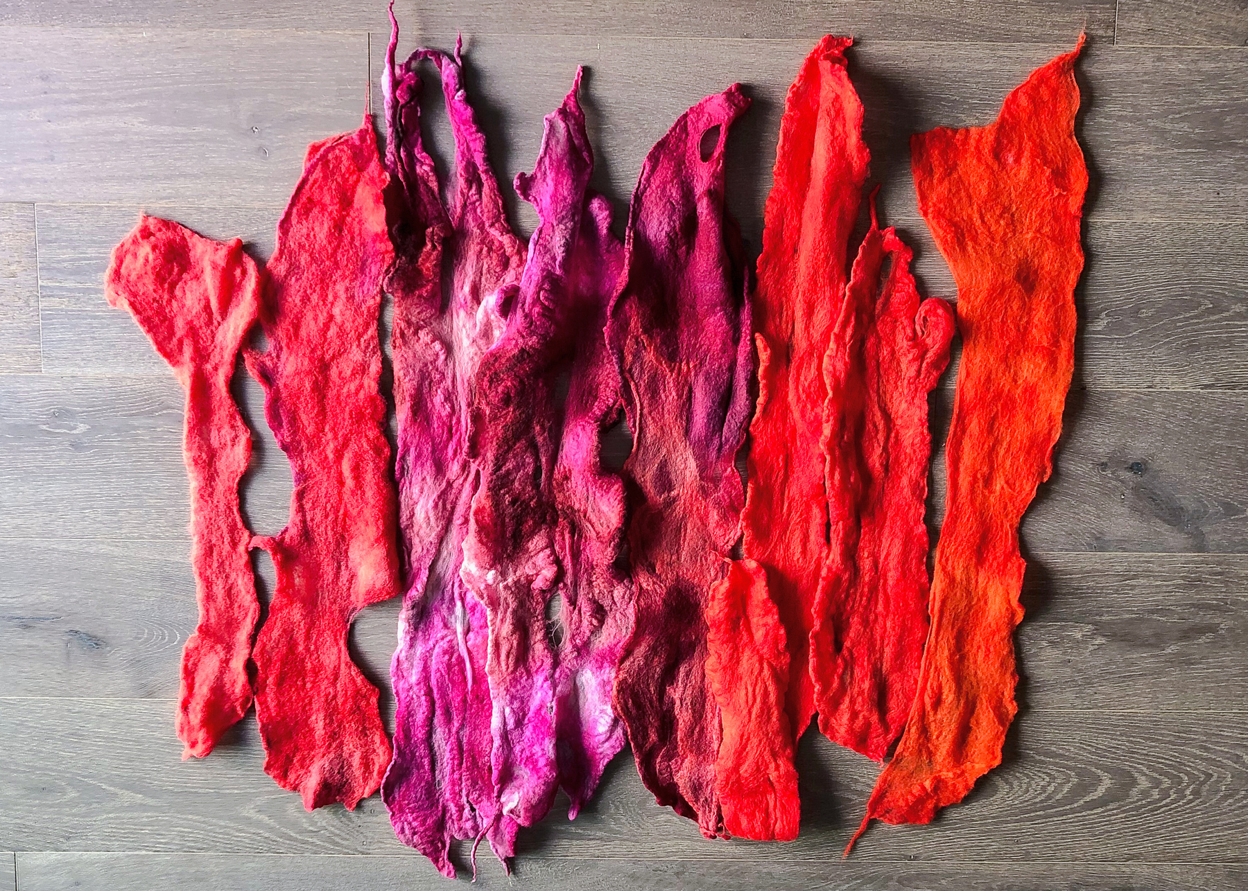 Then, I use wet felting to turn the wool into felt strips.