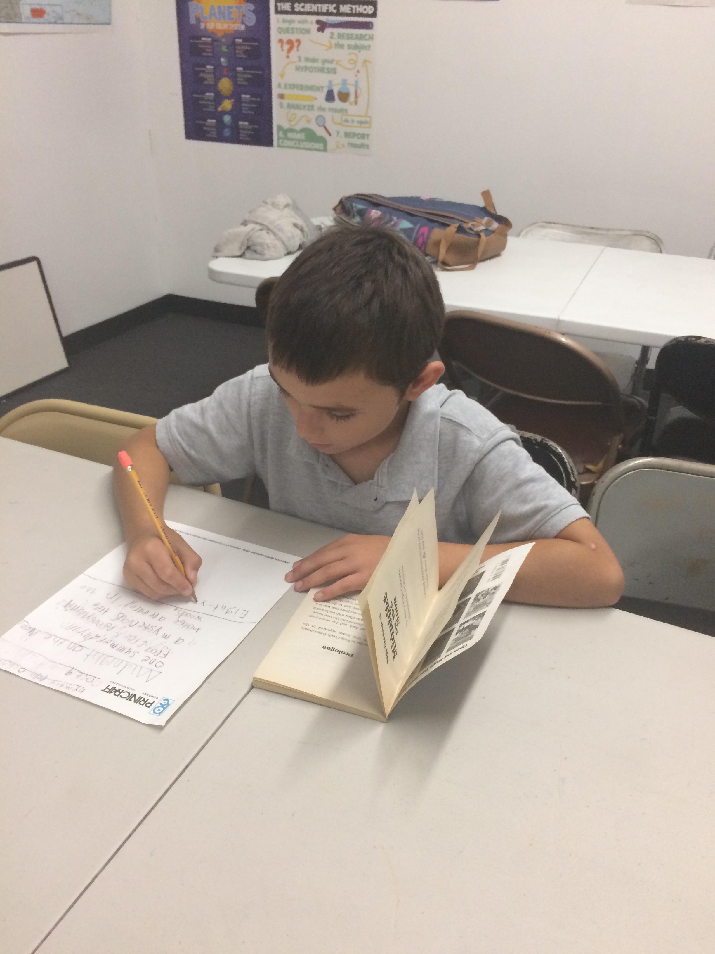 Brock Phillips working on his homework