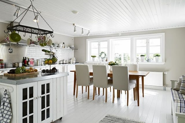 The classic white kitchen with white tile flooring is also a great option.