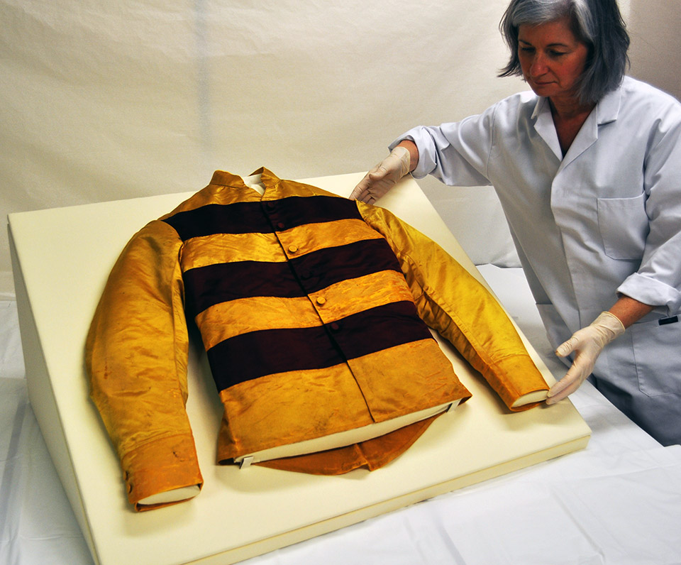 Kate Gill positioning the jacket on the display mount