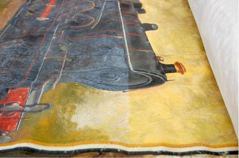 Detail showing cleaning of painted area in progress
