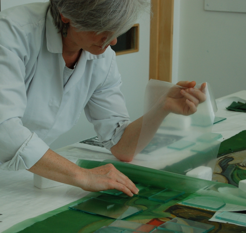 Kate Gill applying a pre-cast adhesive patch support to the reverse face of the banner