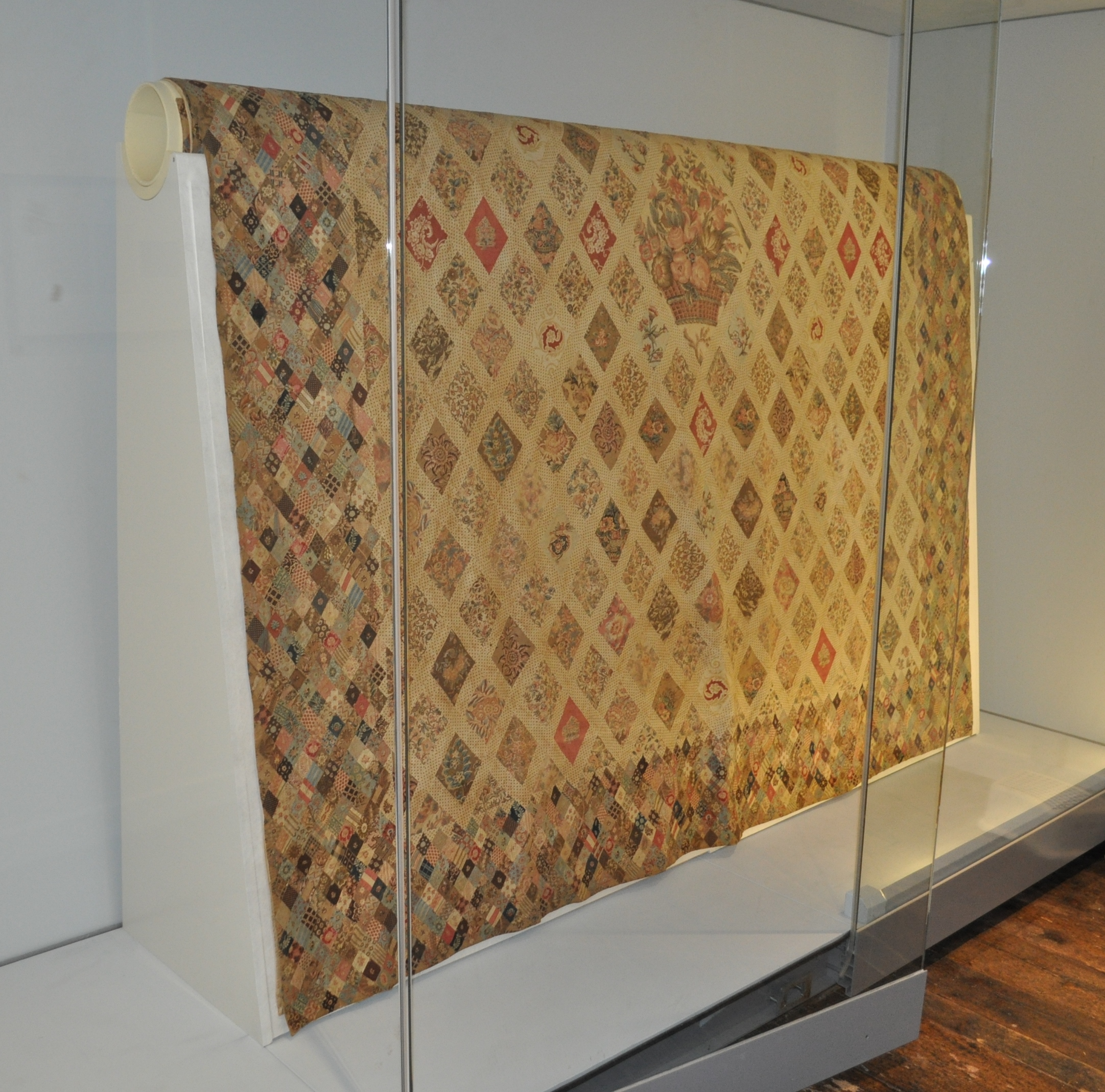 The coverlet on display, after conservation treatment