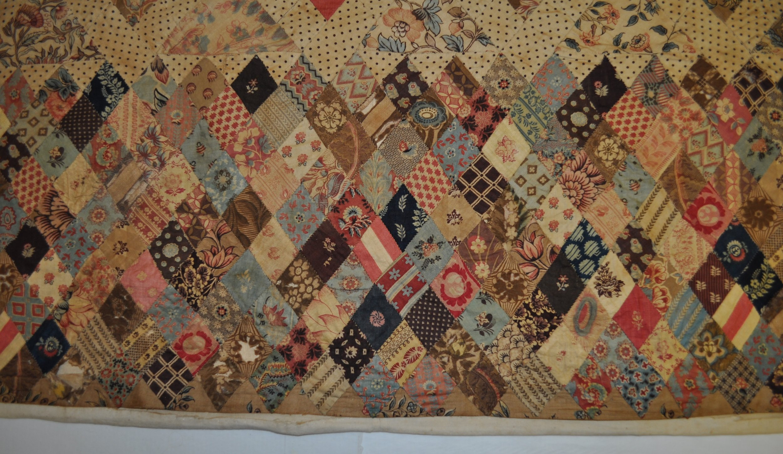 Detail showing the precise pattern symmetry in evidence across the entire patchwork panel