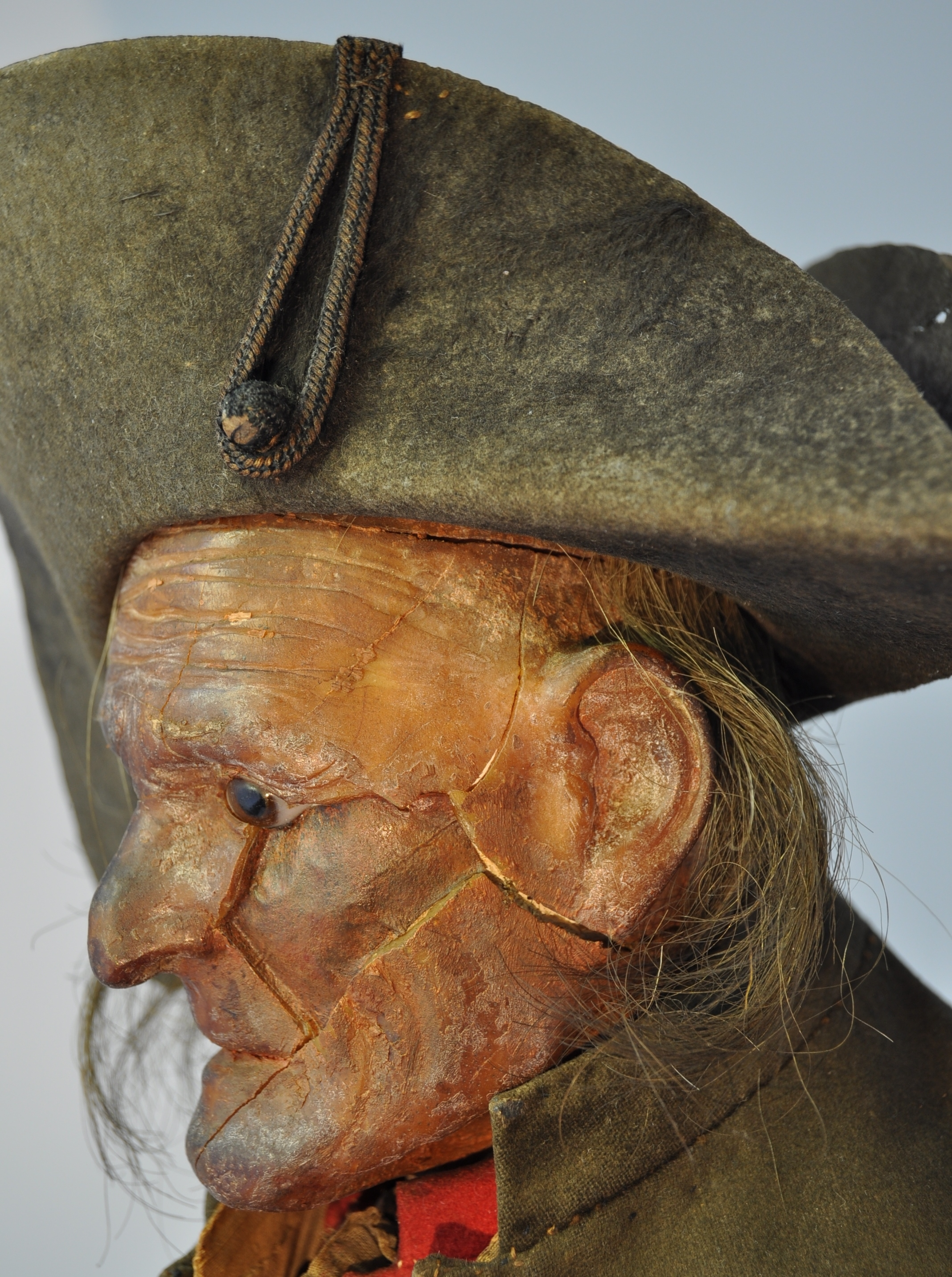 Detail of the head and hat, after conservation treatment