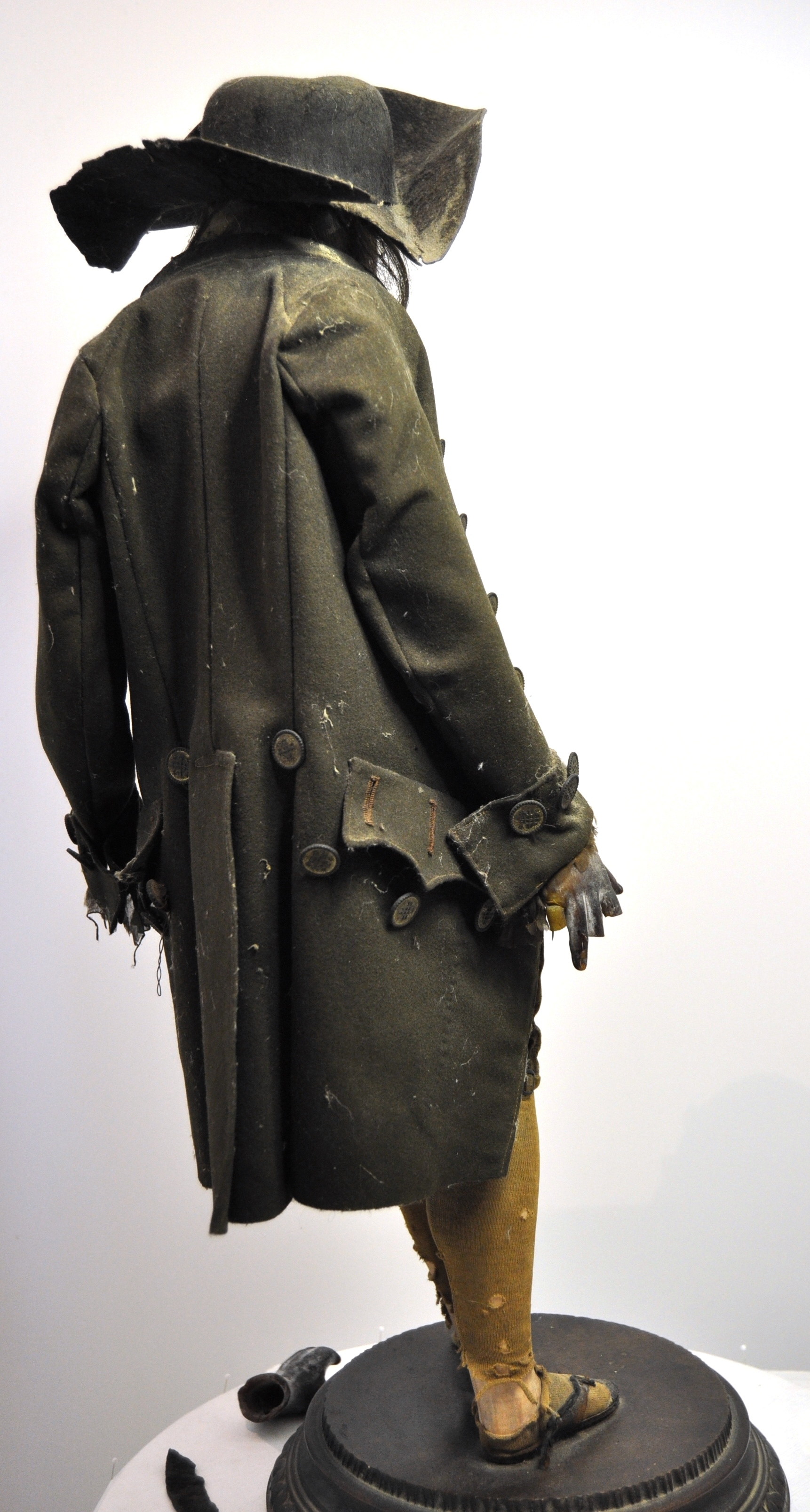 The dressed figure, before conservation