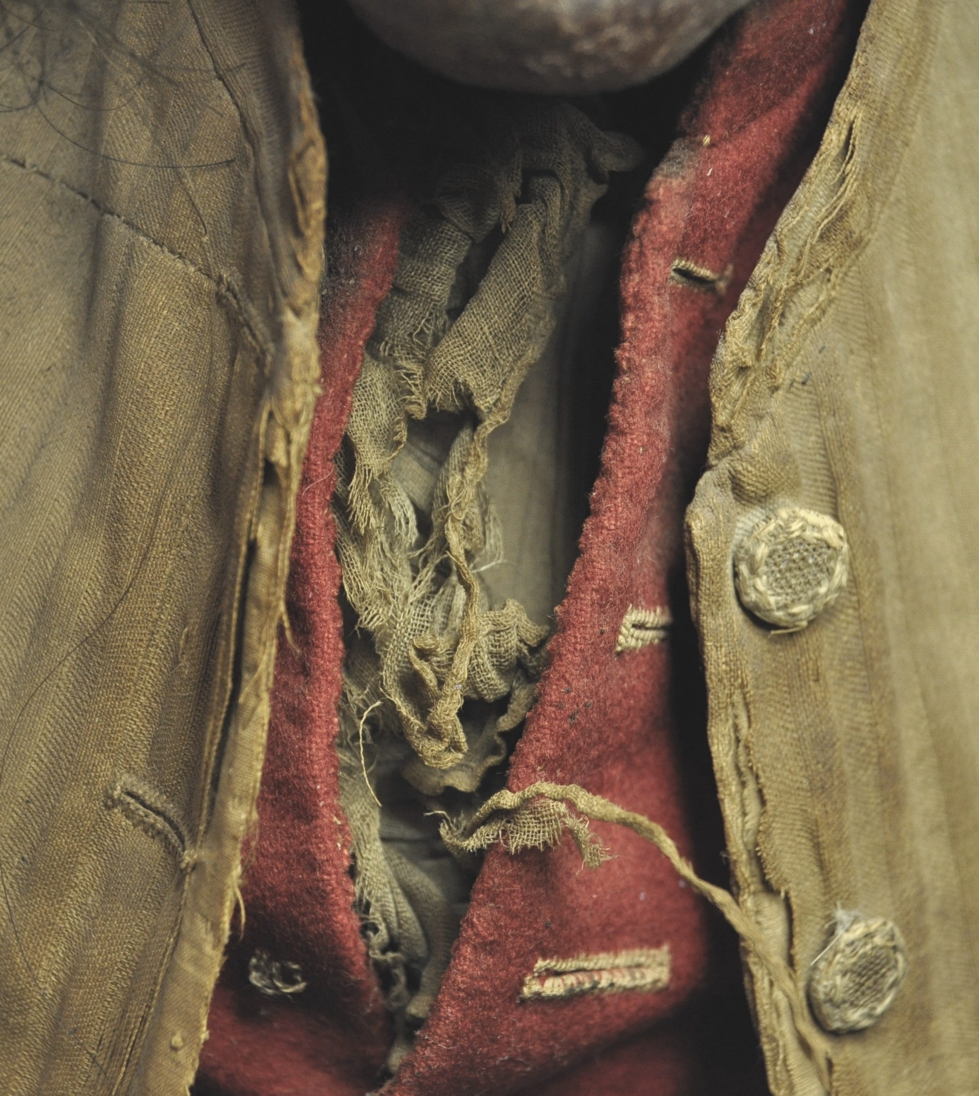 Detail of the cotton shirt, wool waistcoat and silk jacket, before conservation