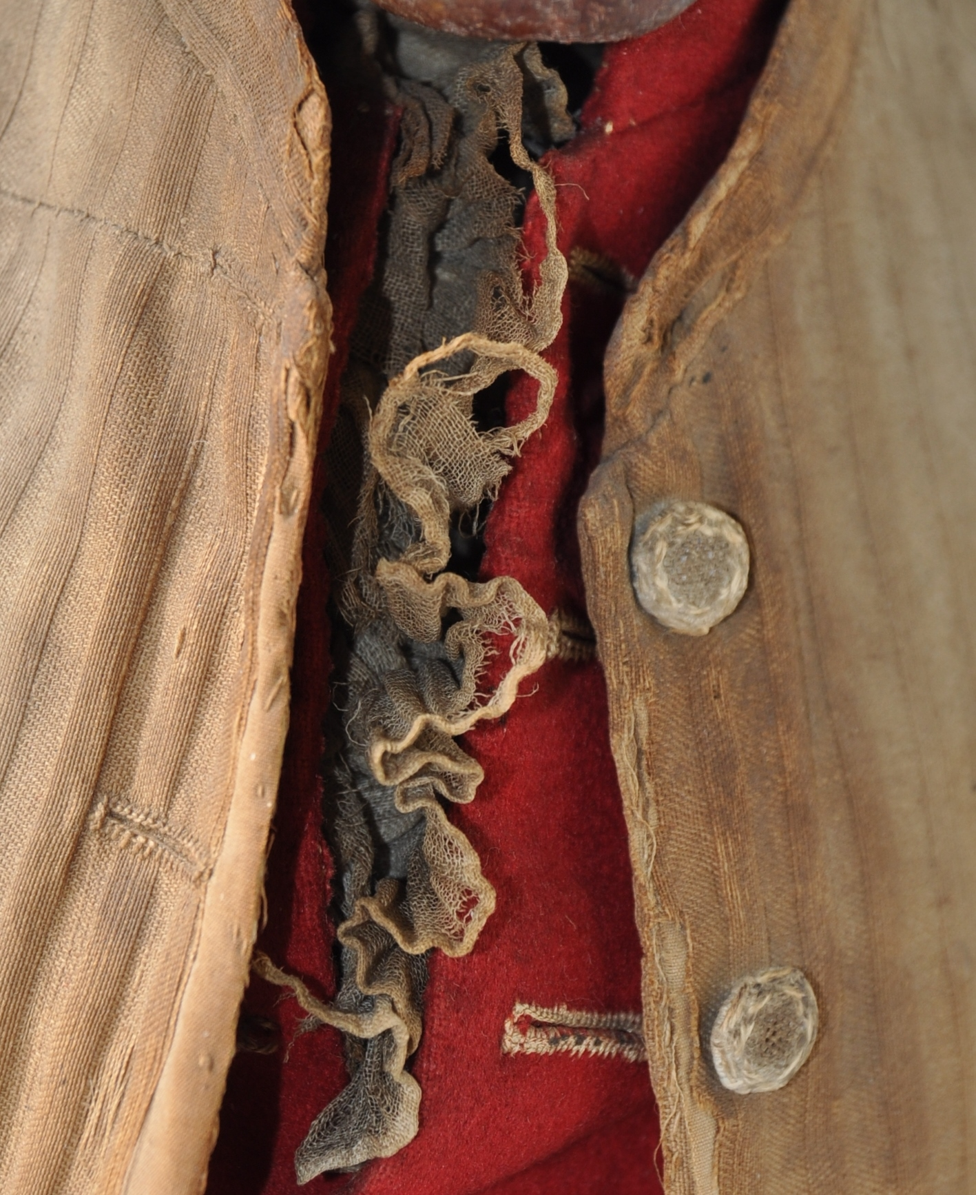 Detail of the cotton shirt, wool waistcoat and silk jacket, after conservation