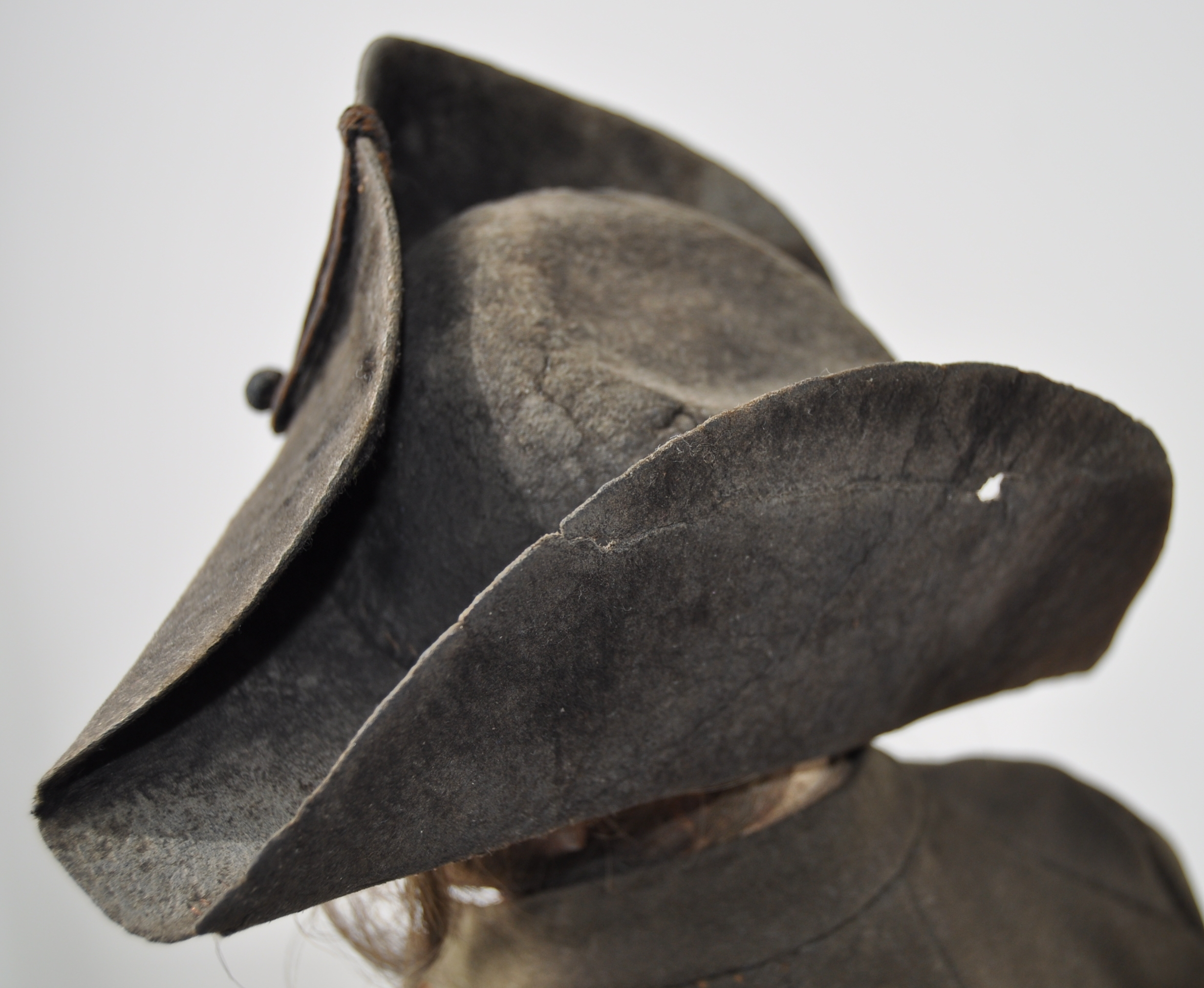 The wool felt bicorn hat, after conservation