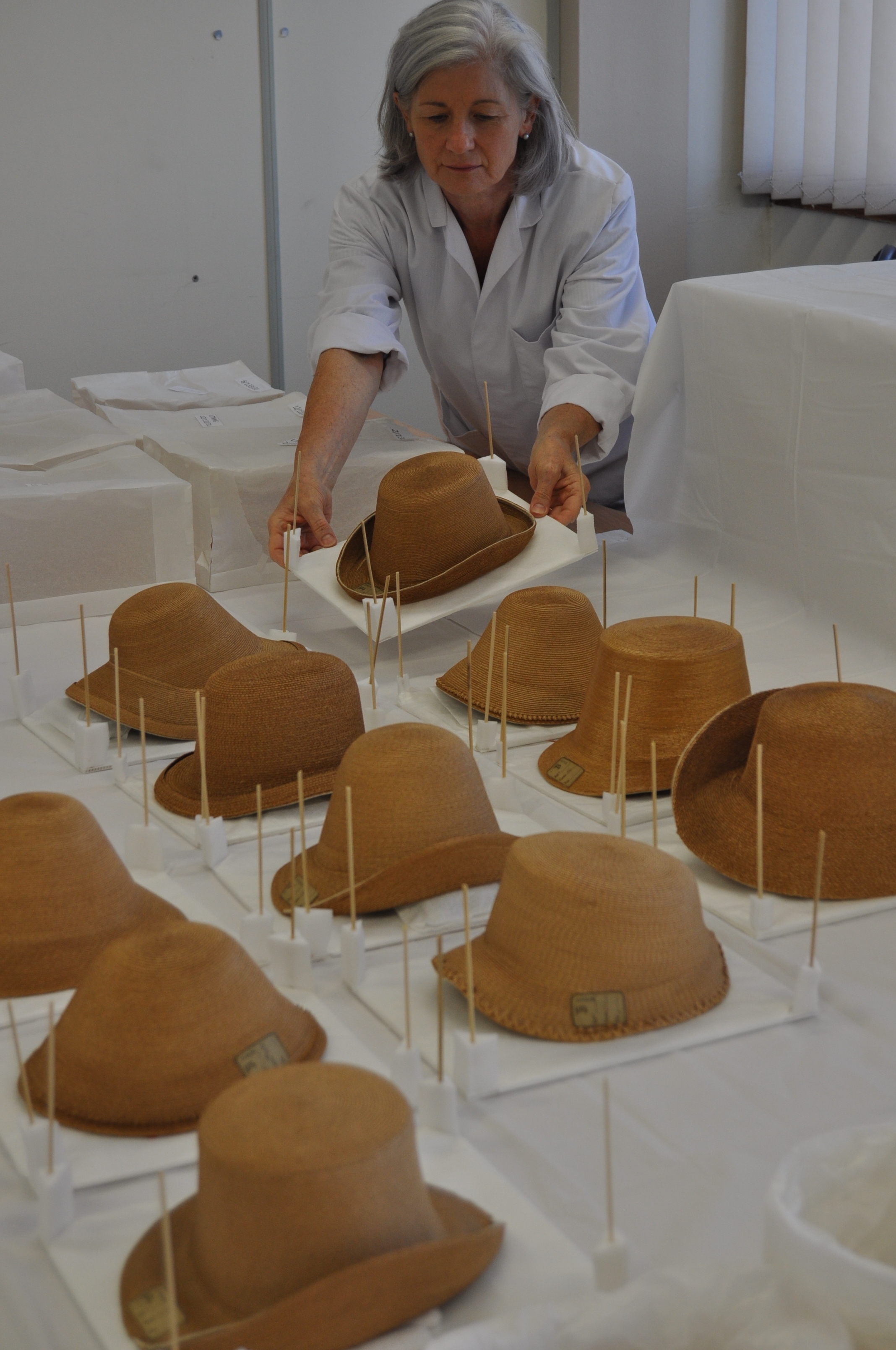 Some of the conserved hats on support forms, in preparation for storage
