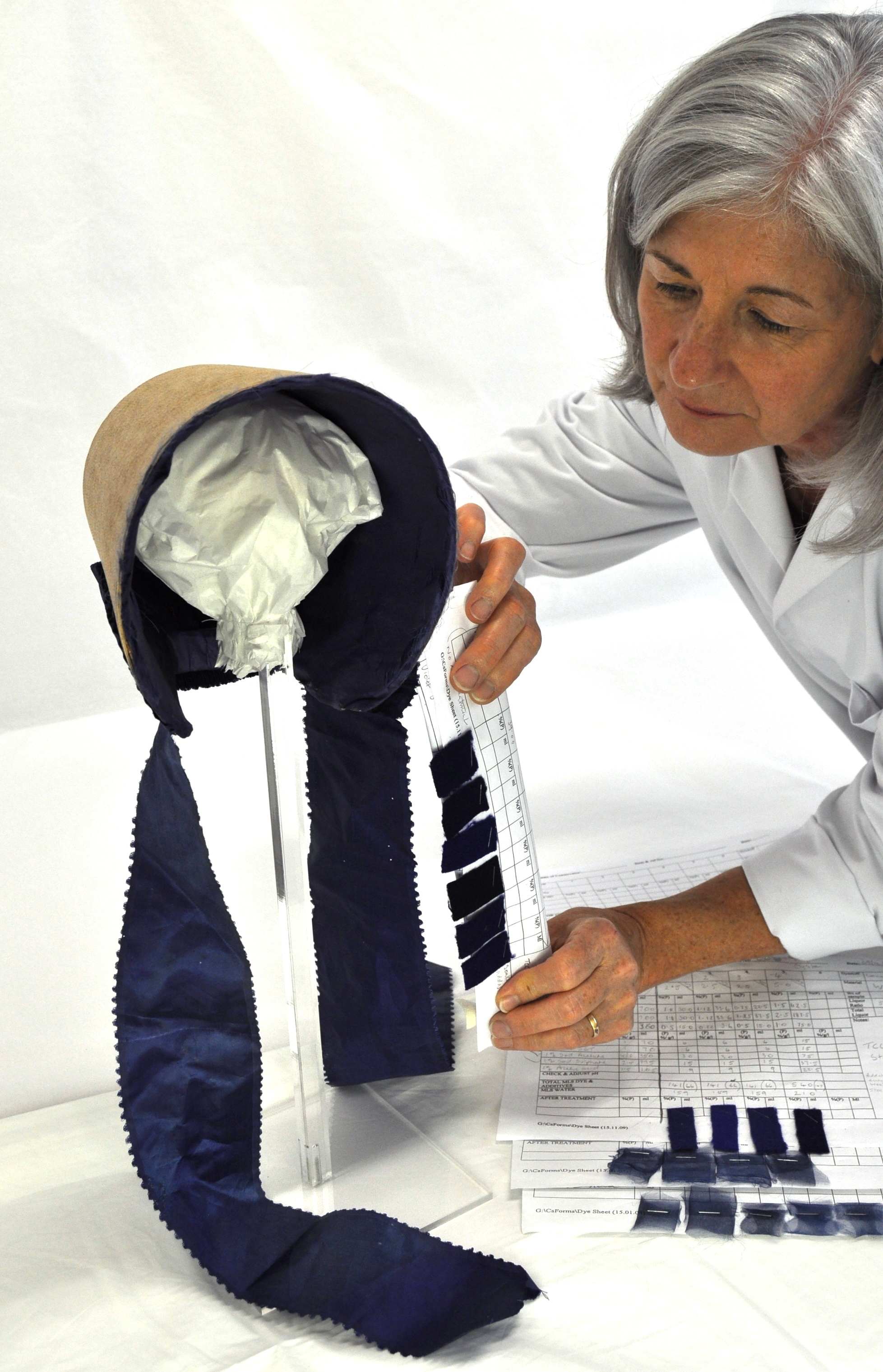 Kate Gill calculating dye recipes for the support fabric