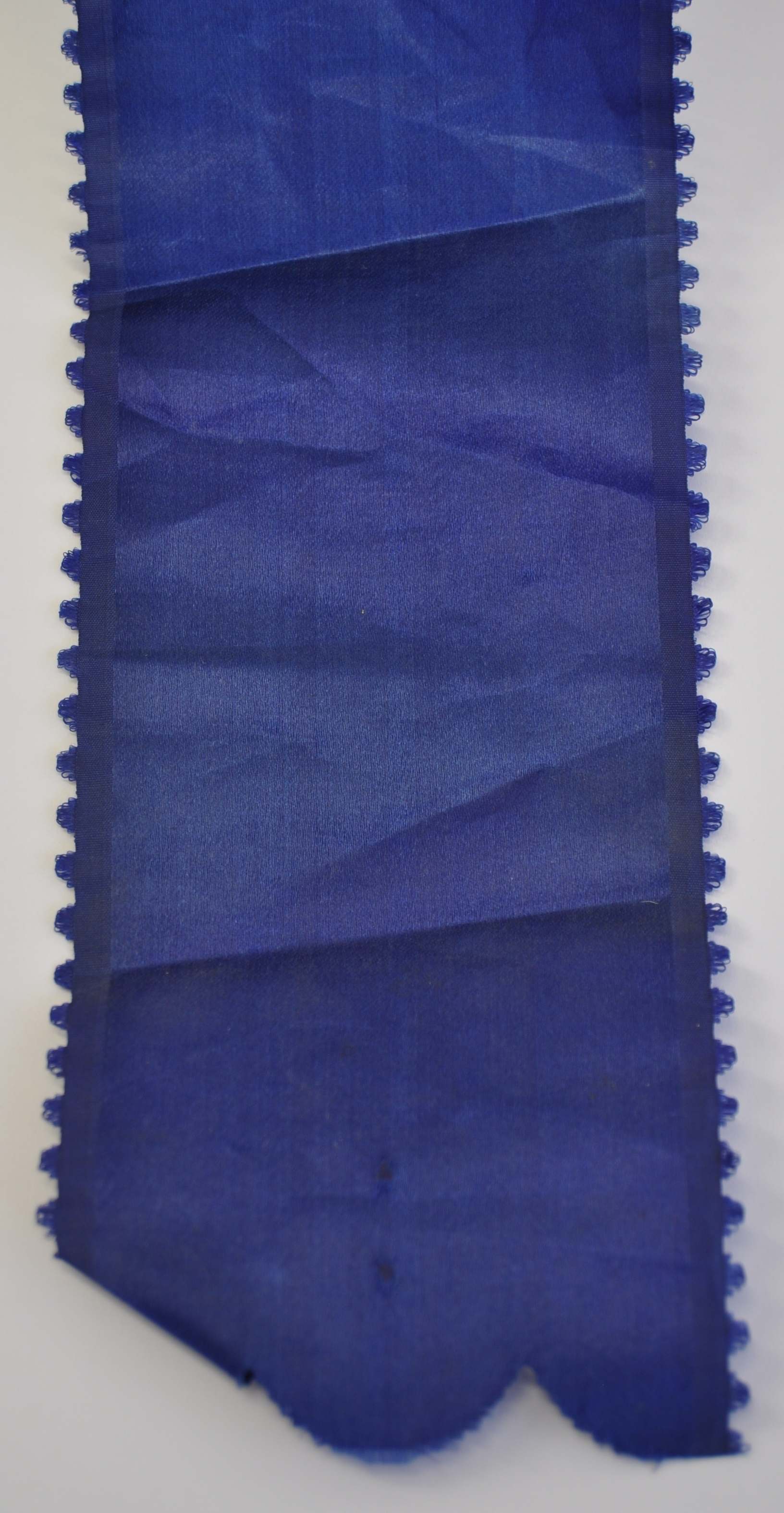Ribbon detail, before conservation