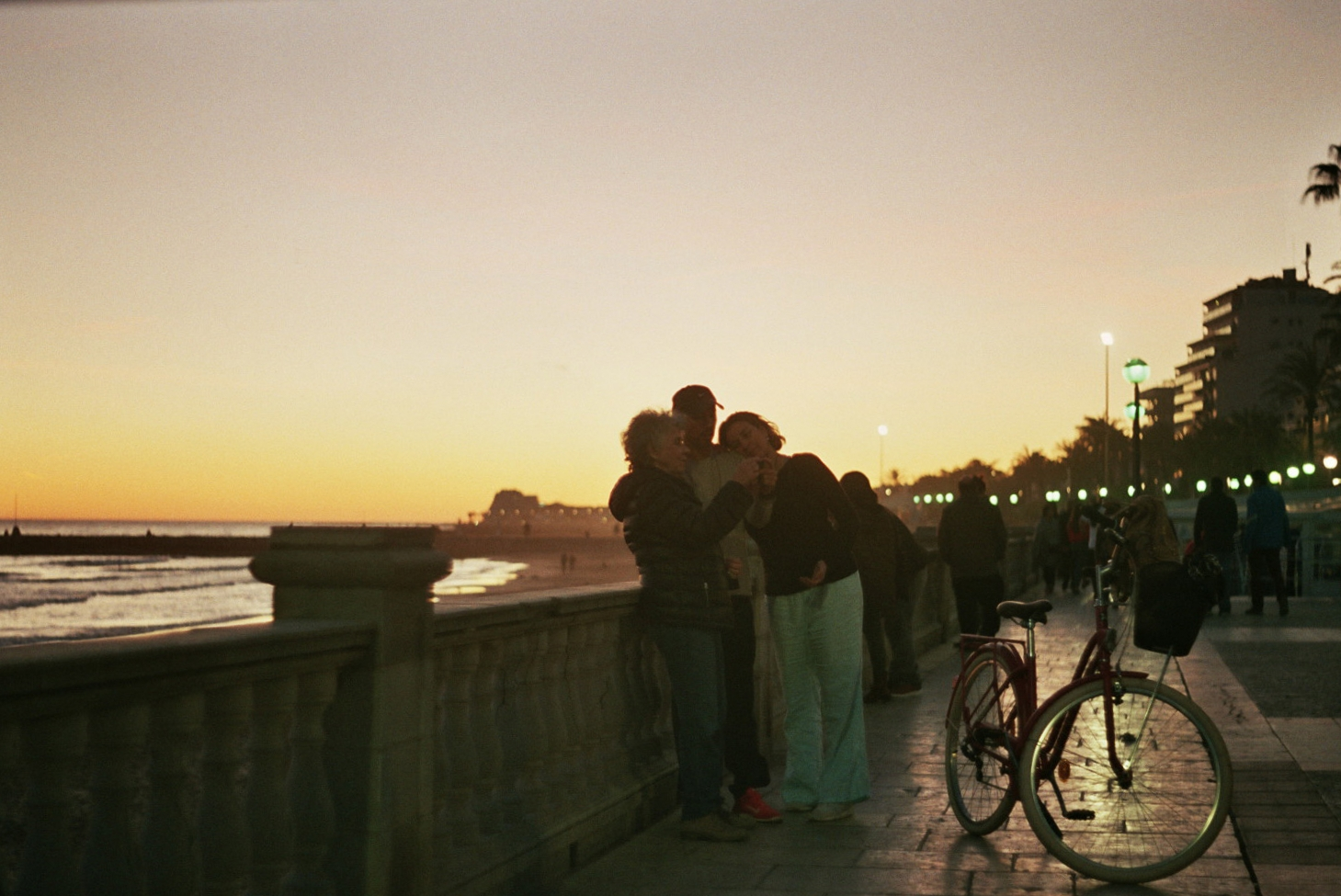 A family enjoying the sunset in Sitges.