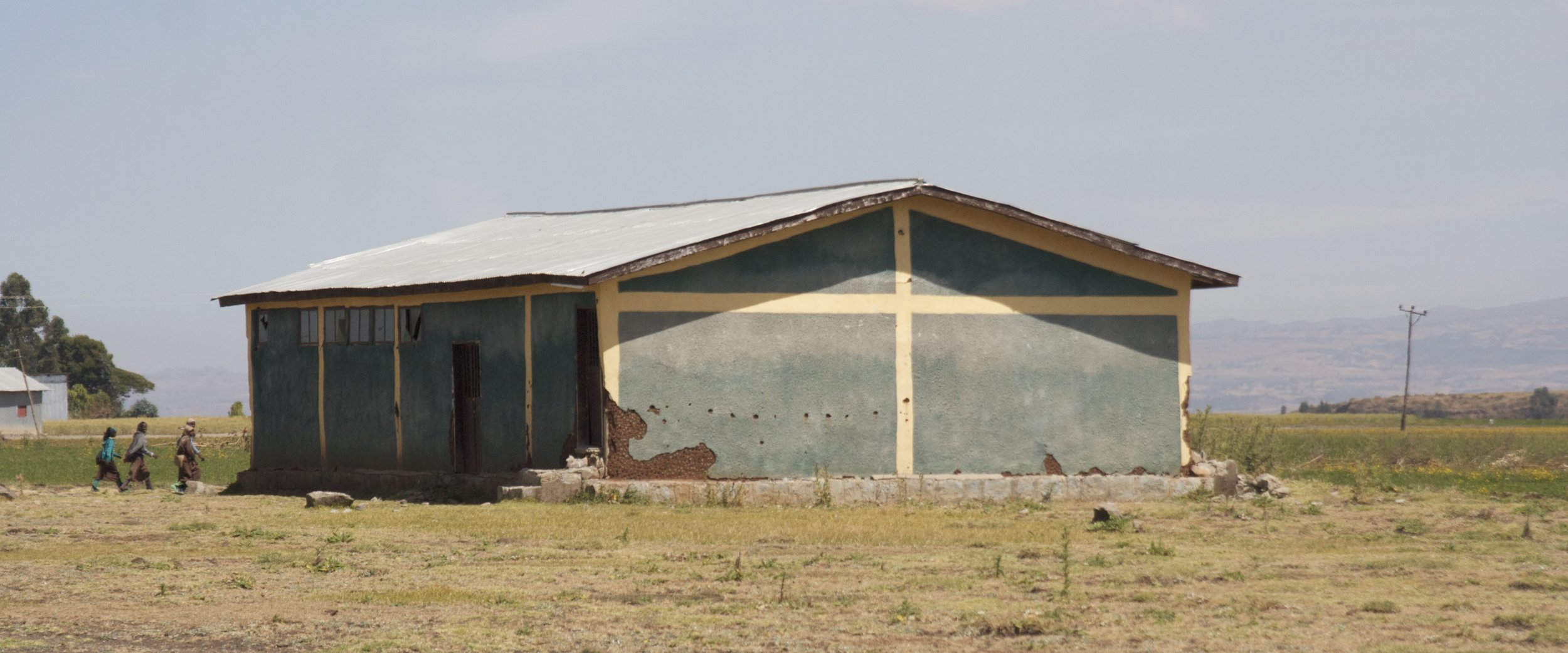 HOLES & YELLOW LINES. AMHARA, ETHIOPIA. NOVEMBER 2016.