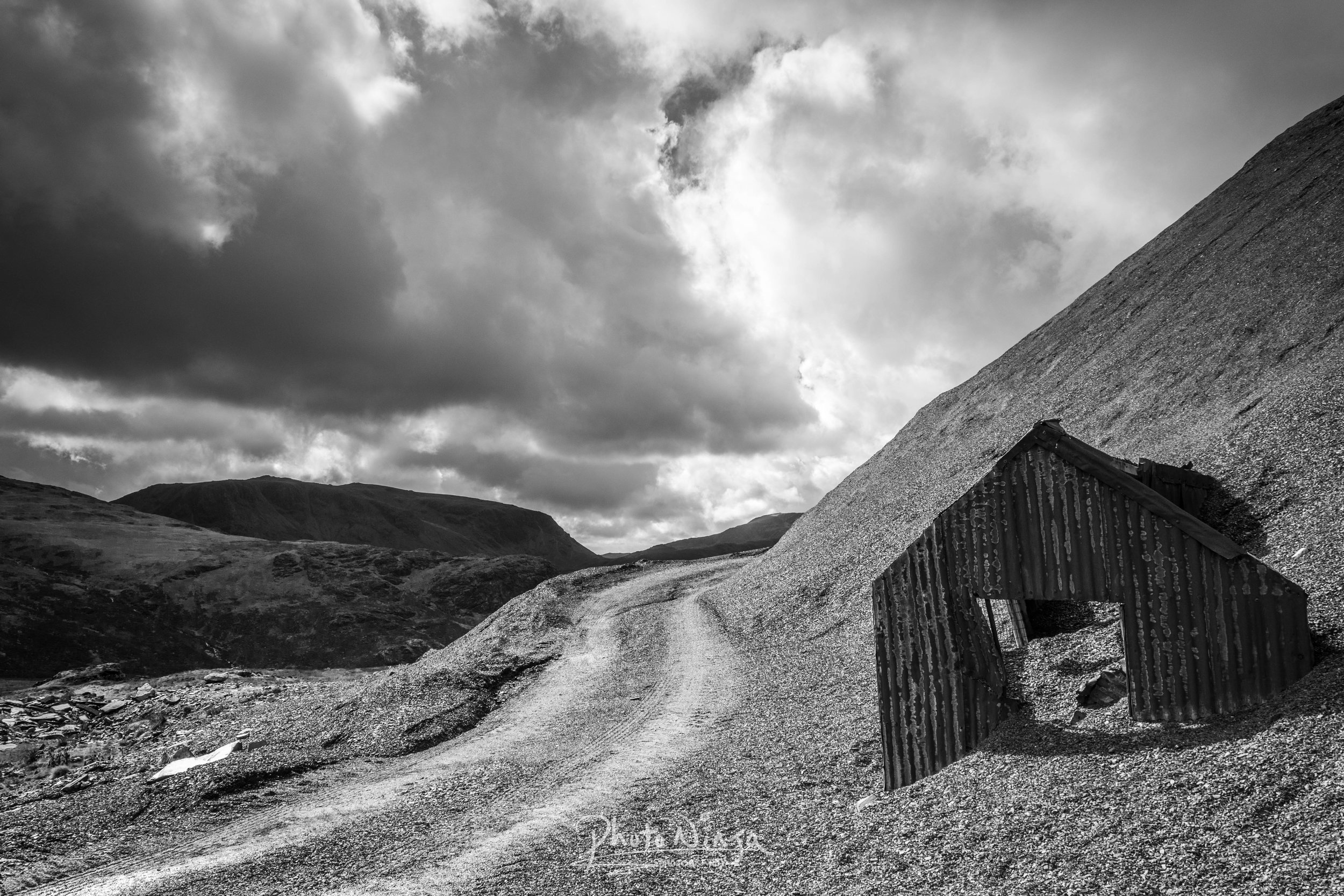 Honister Pass - Whilst on holiday in the lake district, i couldn't resist a trip to Honister slate mine. I use to visit here with my dad and brother, park at the mine and go explore the hills. We set off up the steep winding path with Willow tagging along in the carrier. And it wasn't long before i found my first composition.
