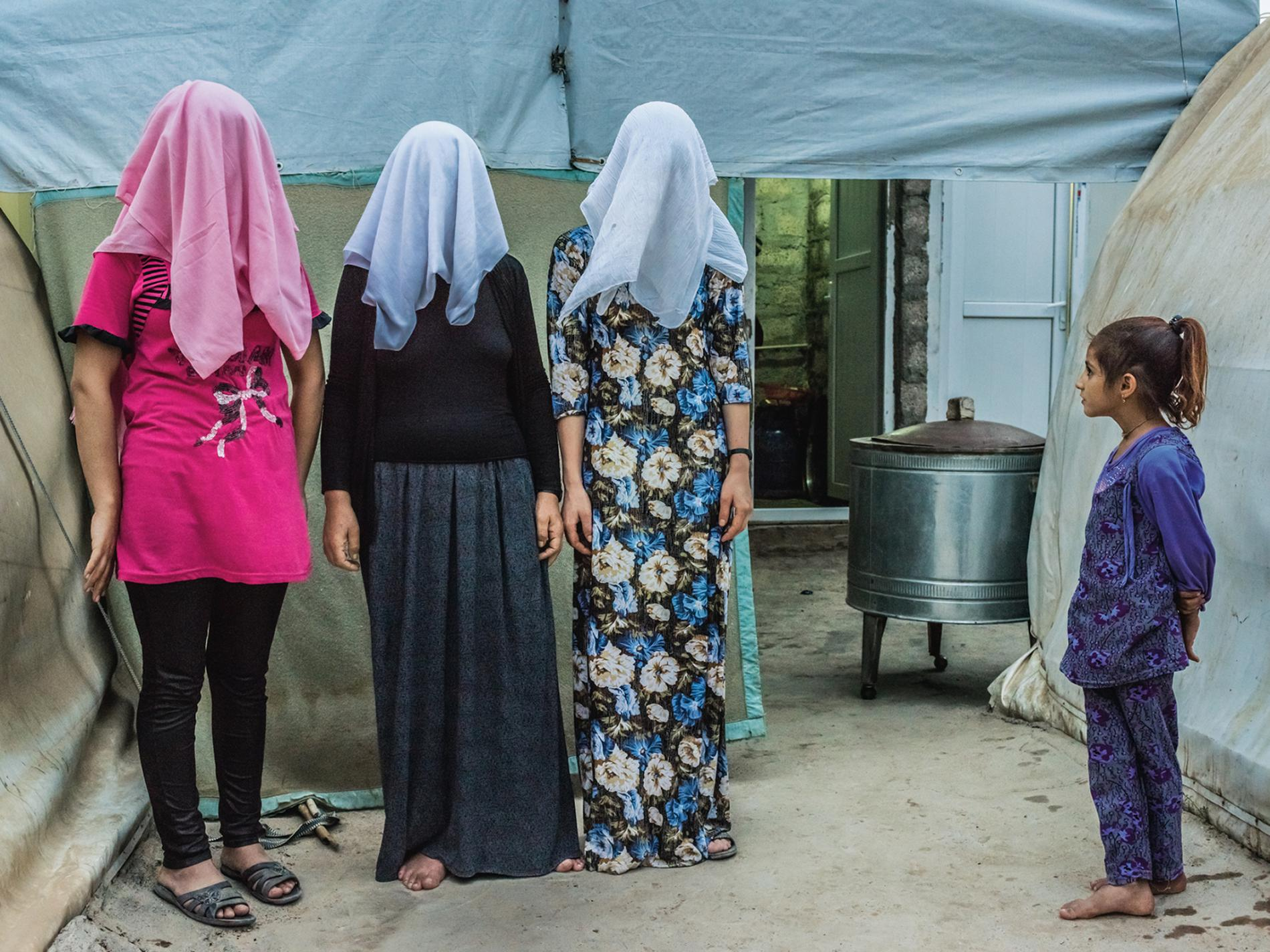 Yazidi womem, former ISIS slaves, at a refugee camp in Kurdistan. Photo by  Yuri Kozyrev .