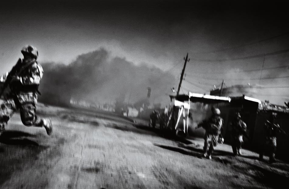 Running for cover in Ramadi, Iraq. Photo by  Andrea Bruce