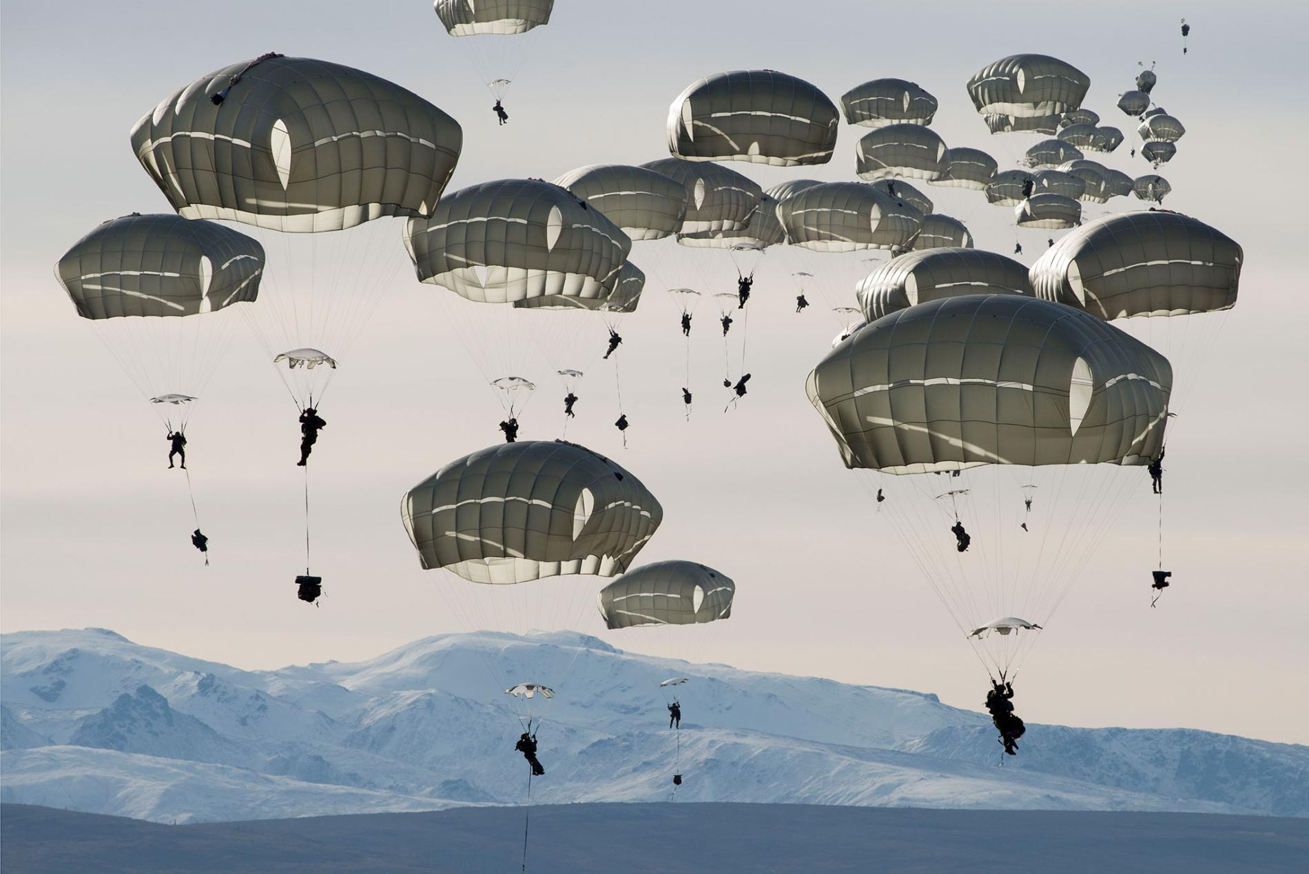 U.S. soldiers drop over the Donnelly Training Area near Fort Greely, Alaska. photo by  Louie Palu .