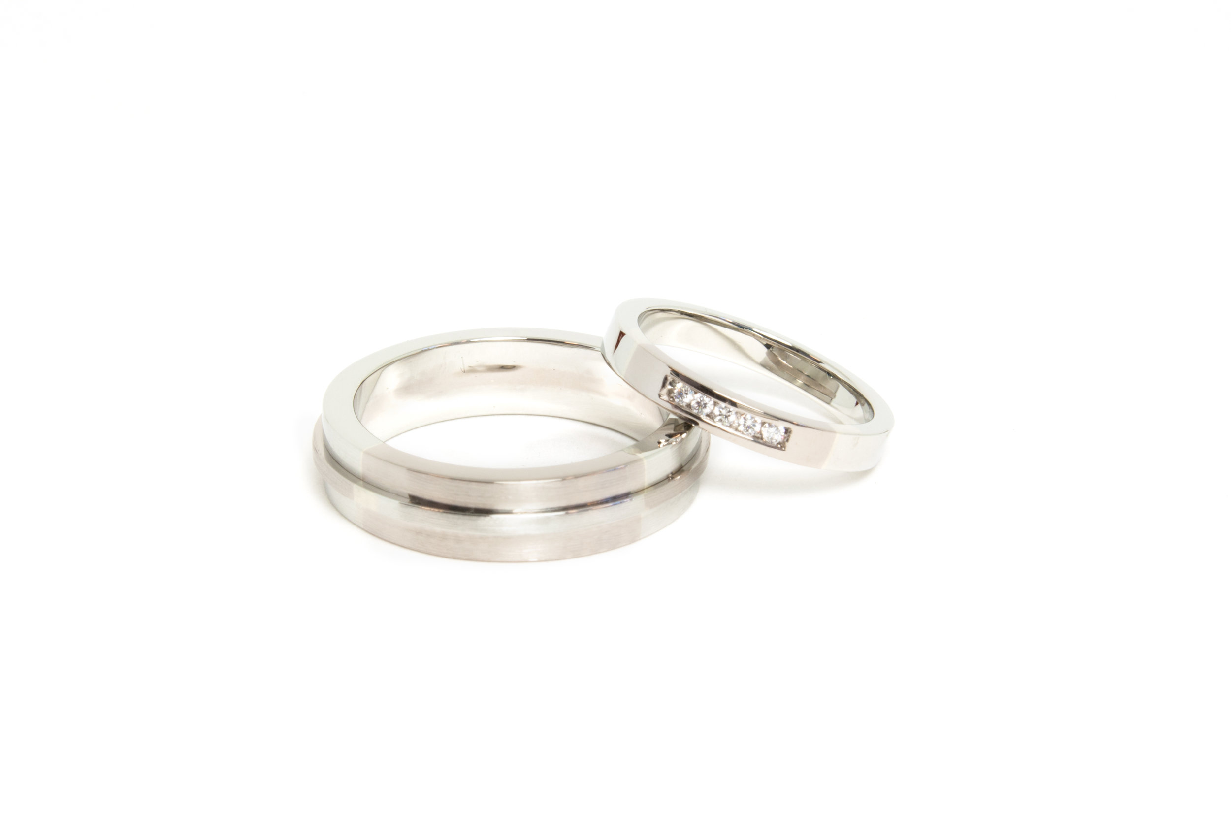 Wedding Bands in 18kt Palladium White Gold and 18kt Gold, with channel set diamonds.