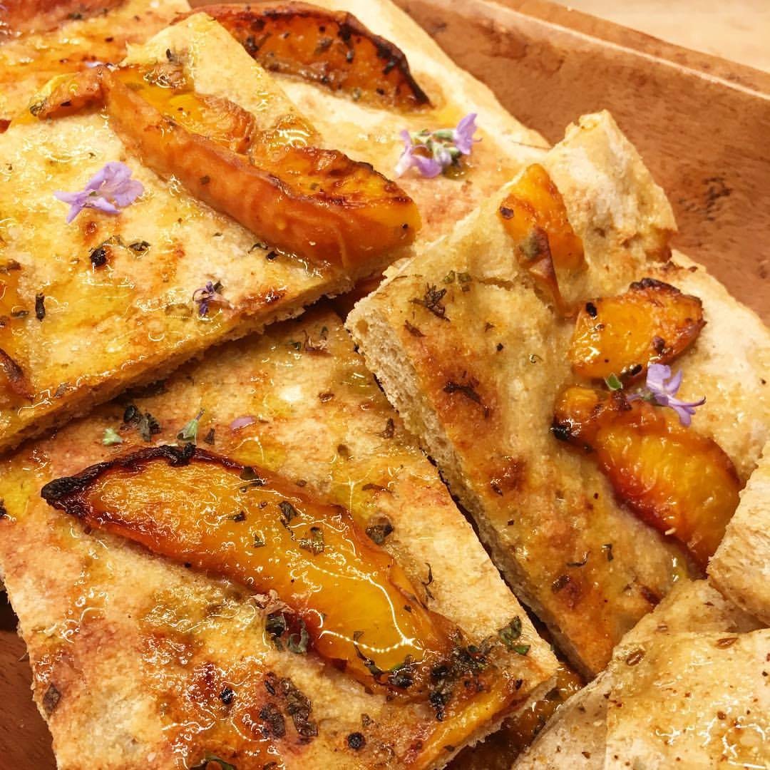 peach flatbread with rosemary blooms