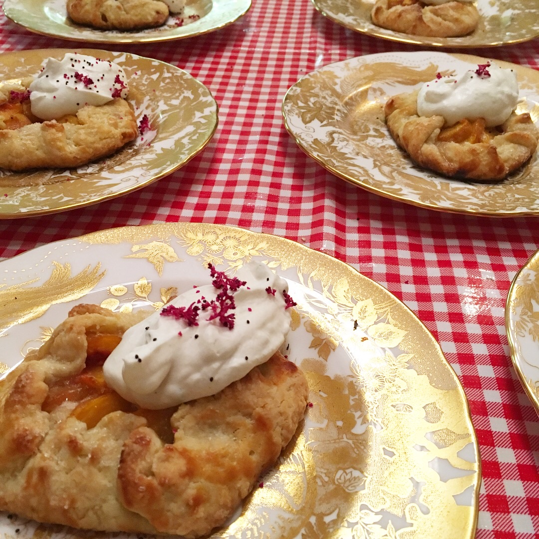 peach galettes with cardamom whipped cream and amarnyth blooms