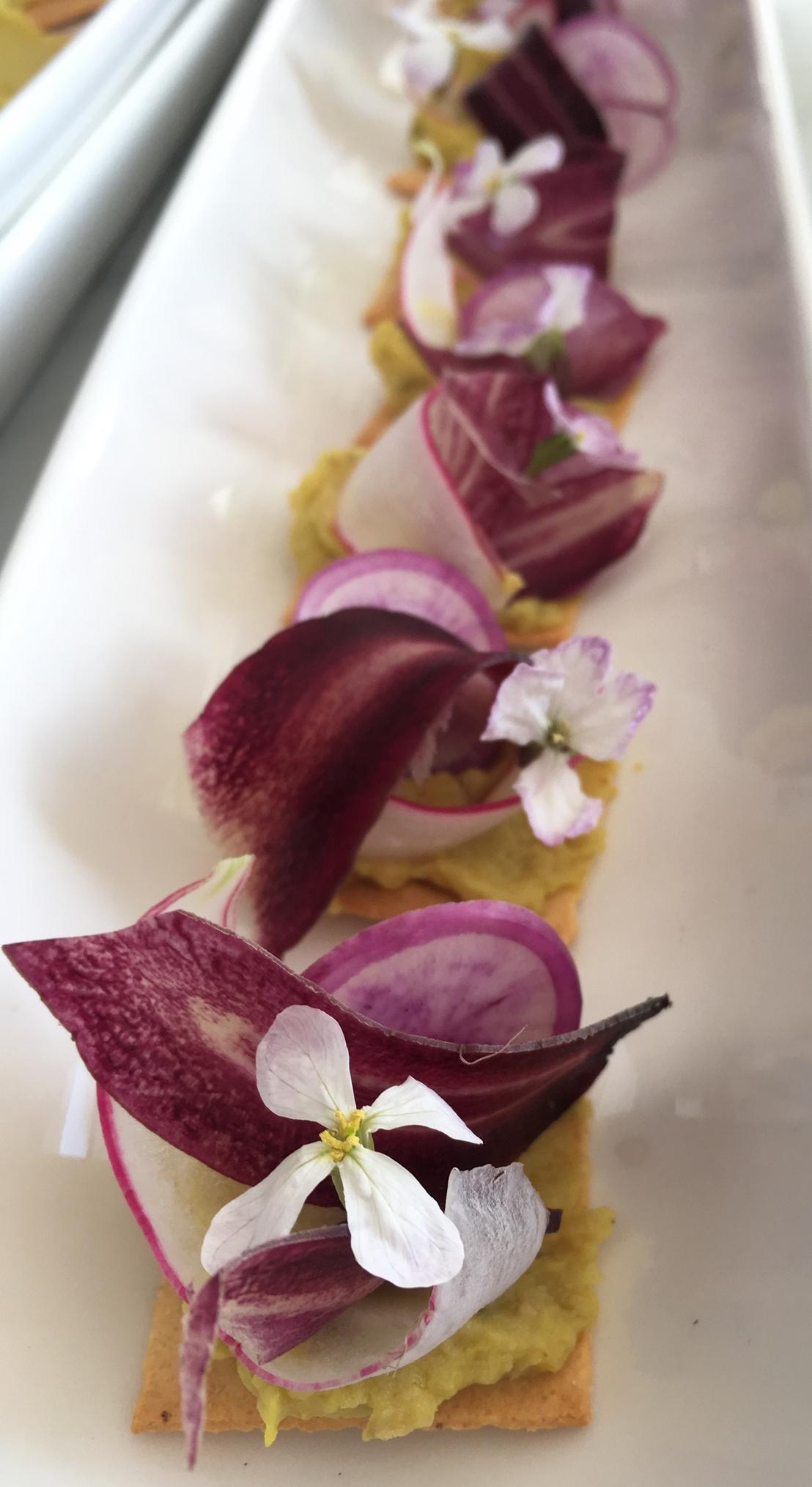 hummus, shaved purple vegatbles, wild radish bloom