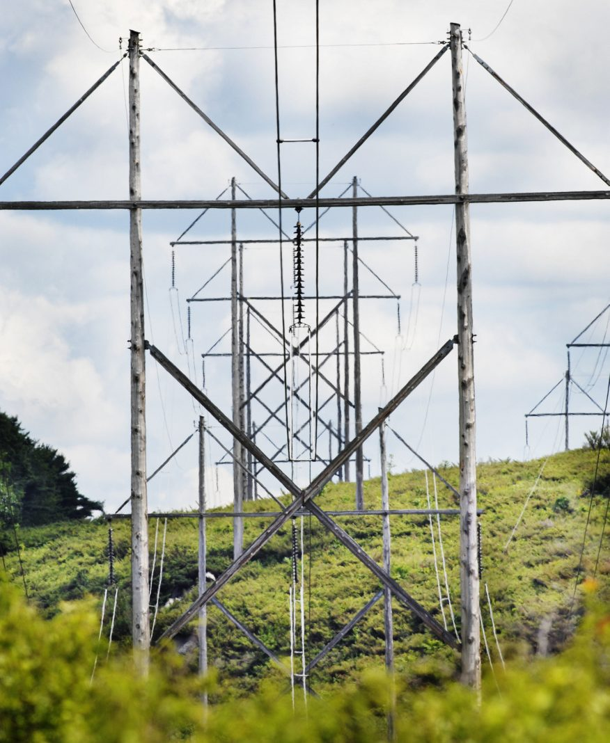 Transmission towers through a clearcut (credit: Portland Press Herald)