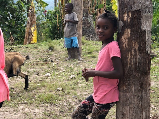 Beauty in Haiti comes in the form of a smiling child.