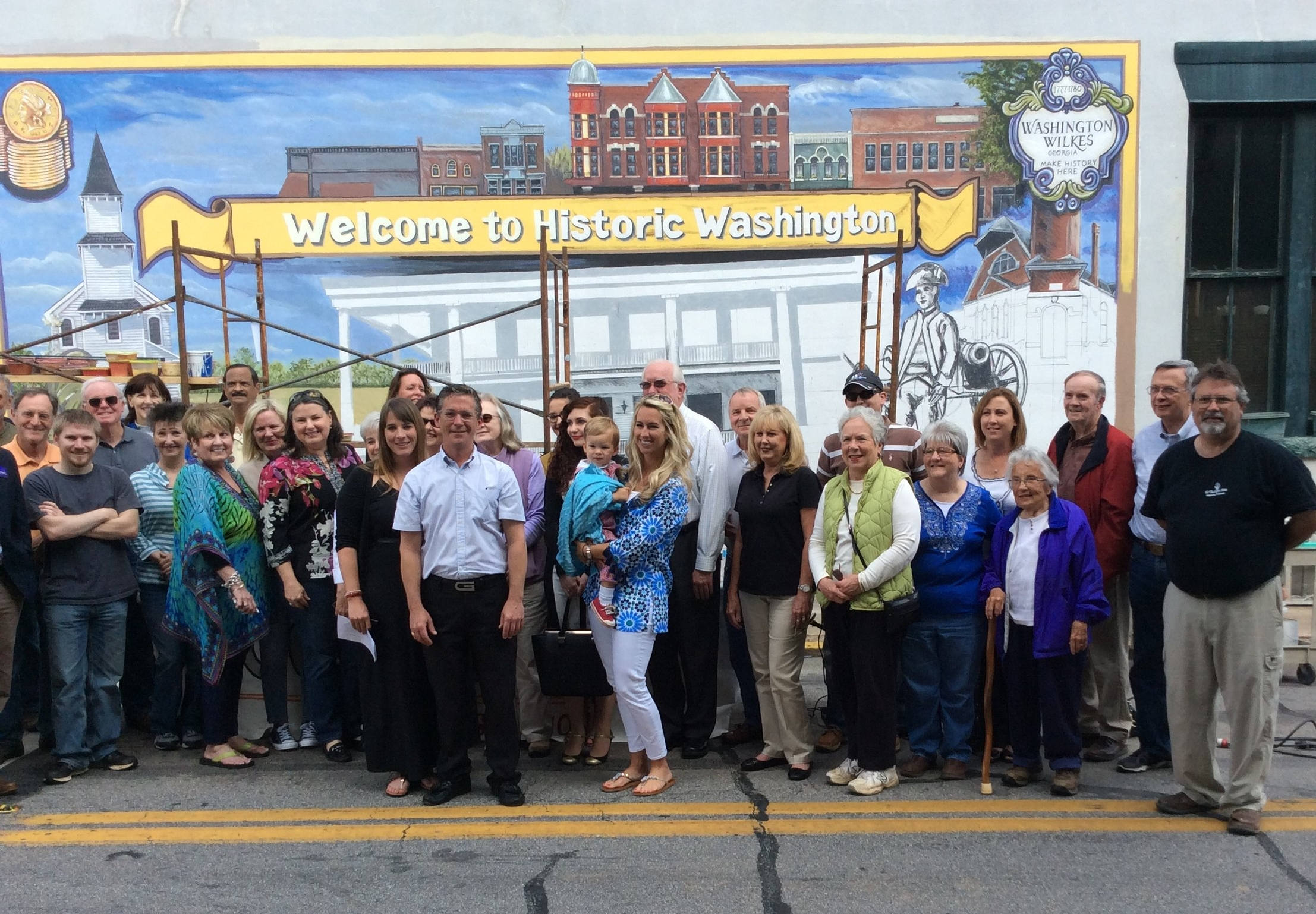Here is our ribbon cutting photo for the Washington mural. There was a great turn out for this.