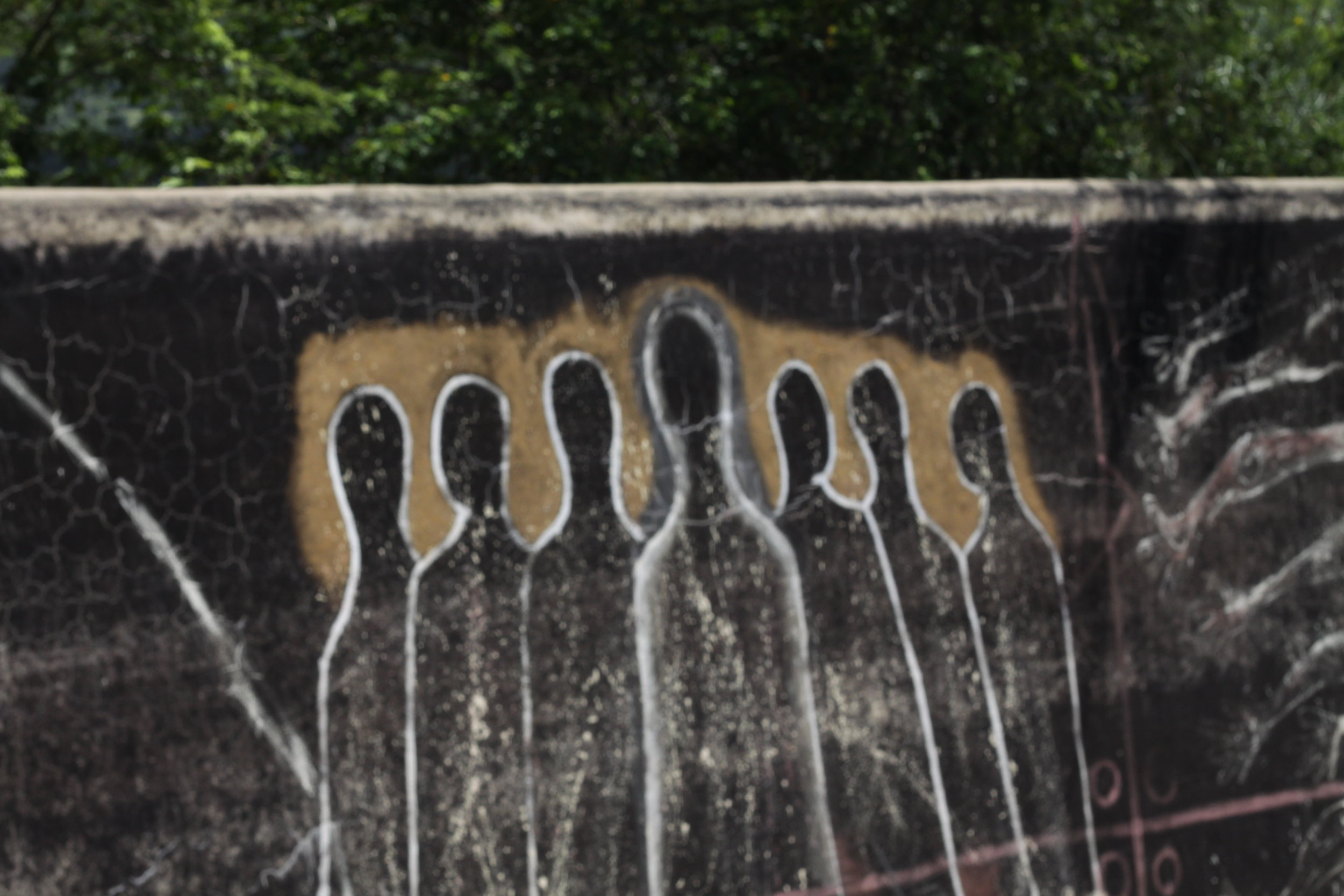 Images on a wall where a former maroon community resided near Santiago de Cuba (July 2012)