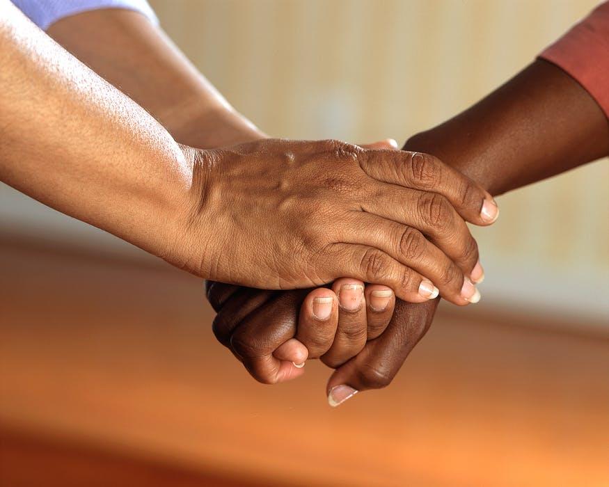 clasped-hands-comfort-hands-people-45842.jpeg