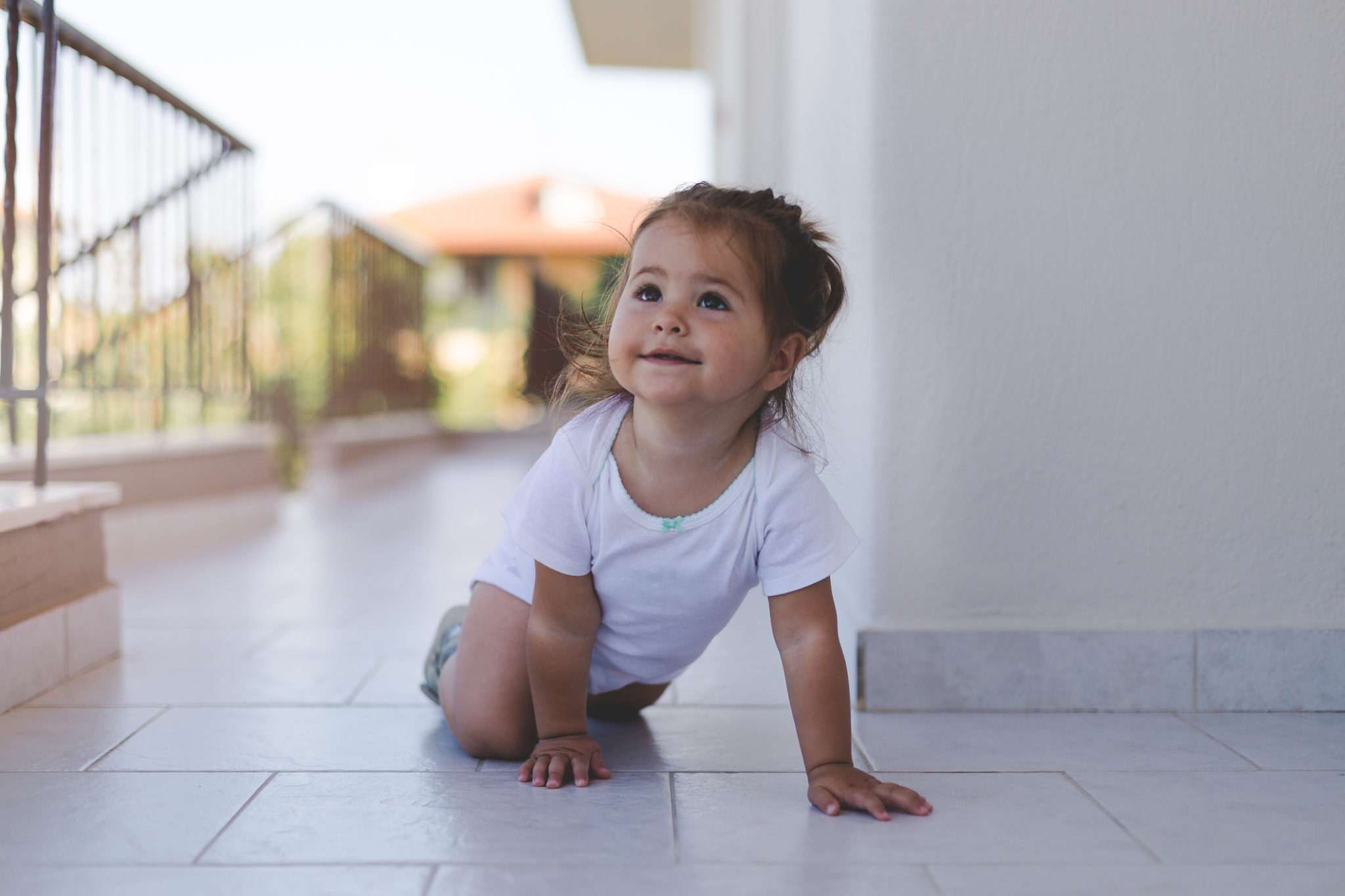 baby on tile exterior patio