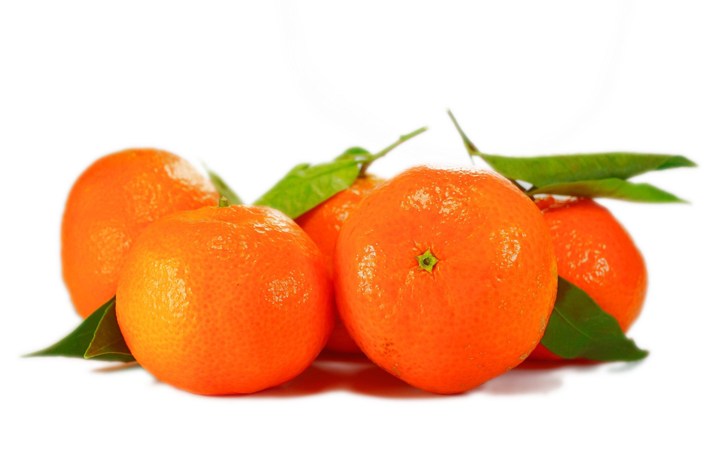 Oranges on white surface.