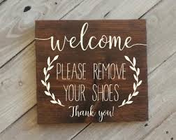 wooden sign that asks to remove your shoes