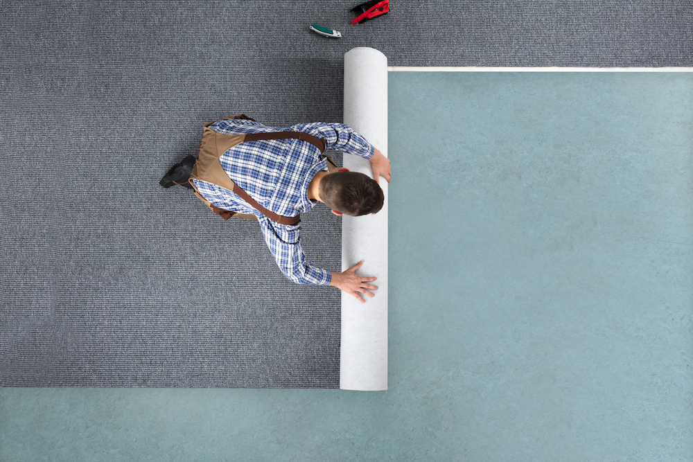 rolling-out-natural-and-organic-carpet-that-is-brand-new-from-above.jpg