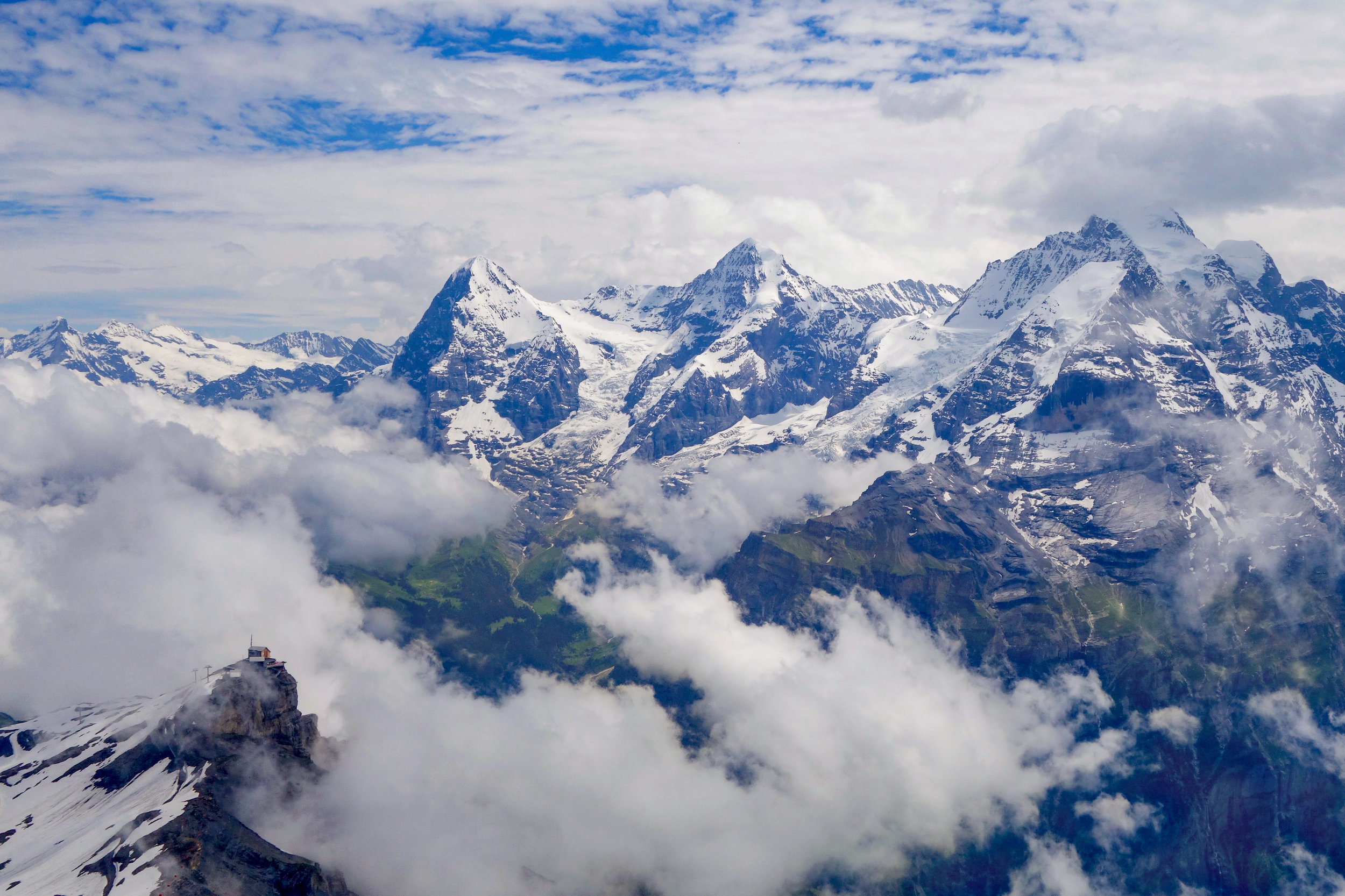 View of the Eiger, Mönch, and Jungfrau from the top of Schilthorn, with the mid-station stop of Birg in the foreground.