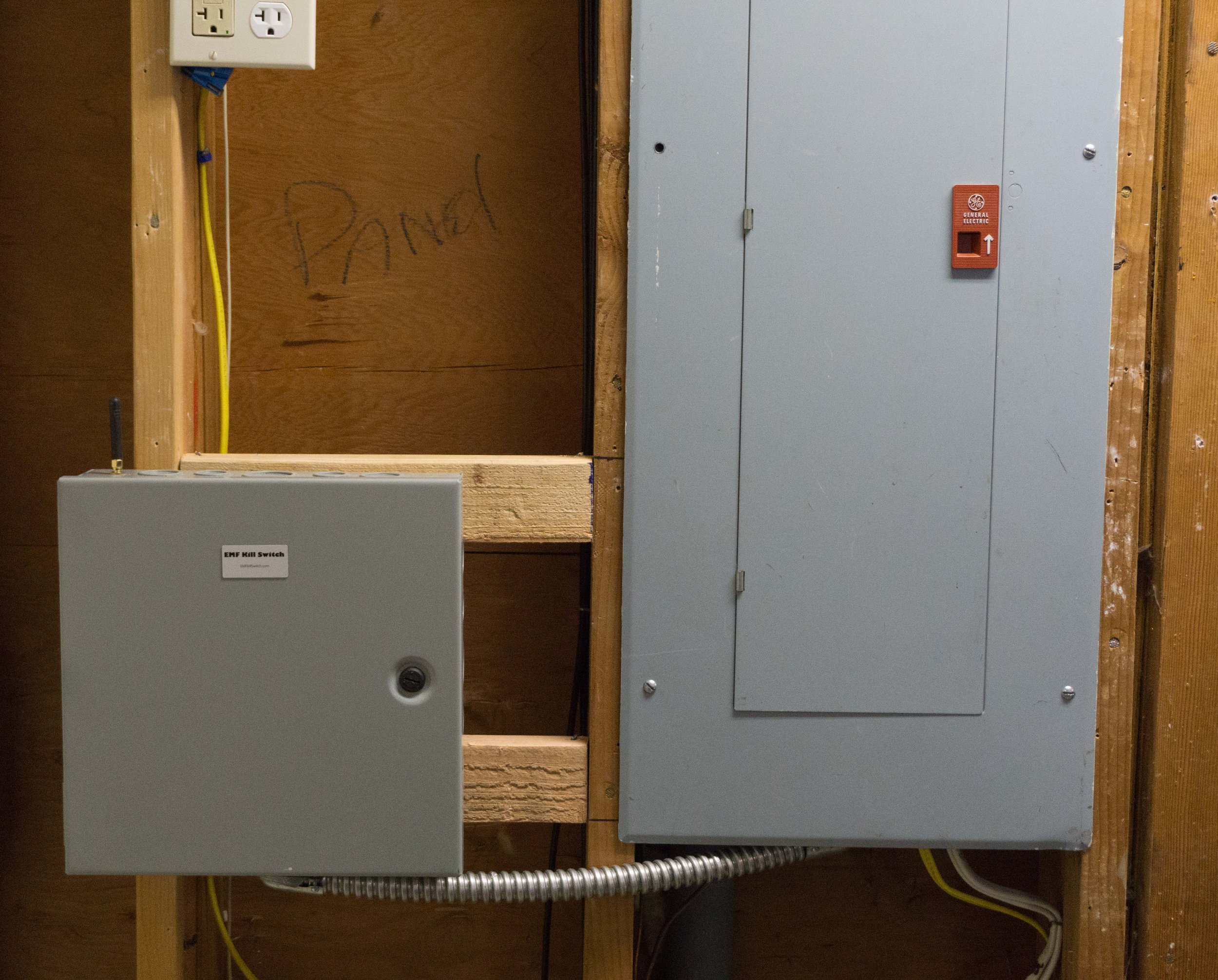 THIS PICTURE SHOWS A TYPICAL GARAGE INSTALLATION WITH THE EMF KILL SWITCH MOUNTED NEXT TO THE HOME'S MAIN ELECTRICAL PANEL.