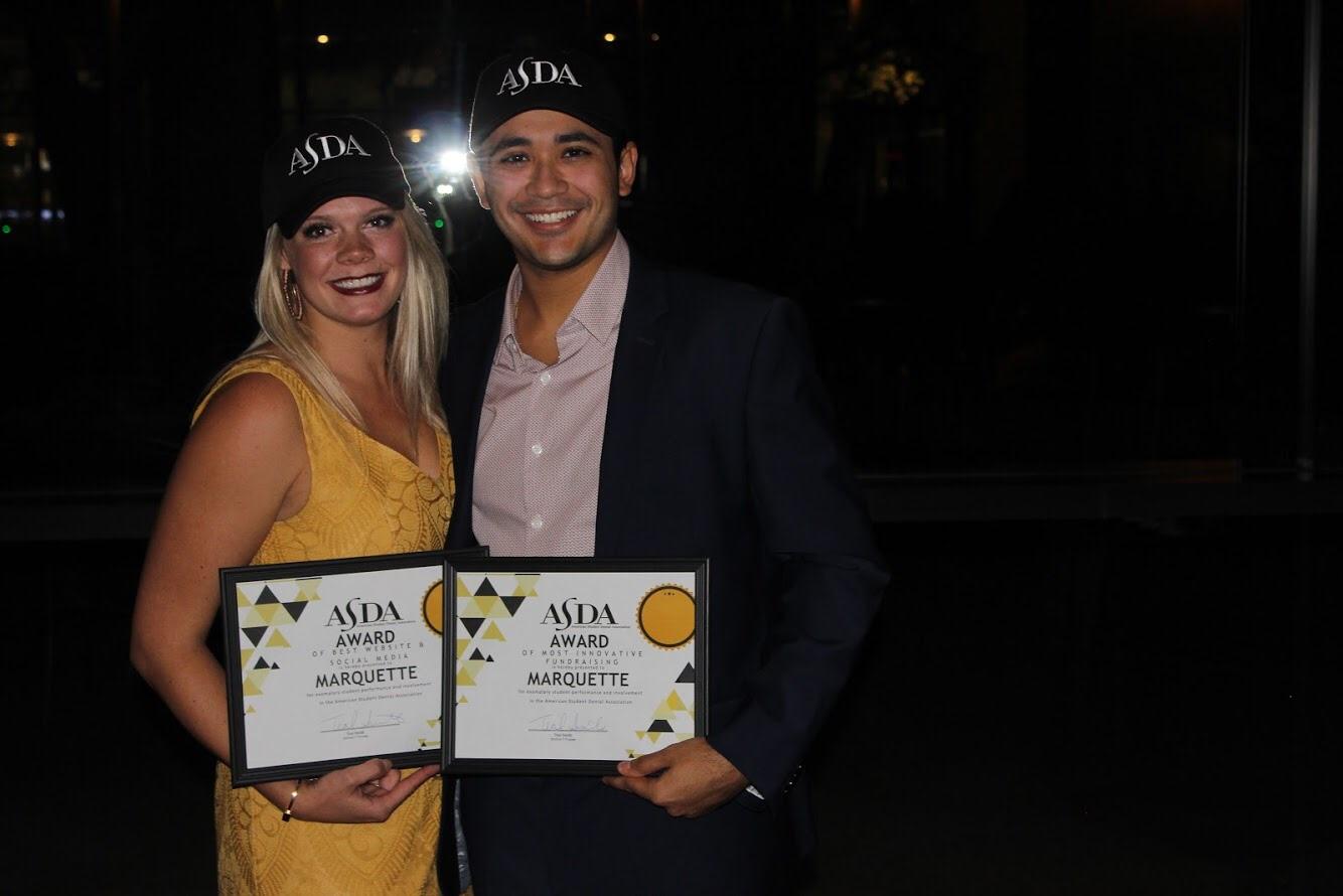 Angela Schmidt (Social Media Chair) and Jesus Echezerreta (Treasurer) with Marquette's District awards