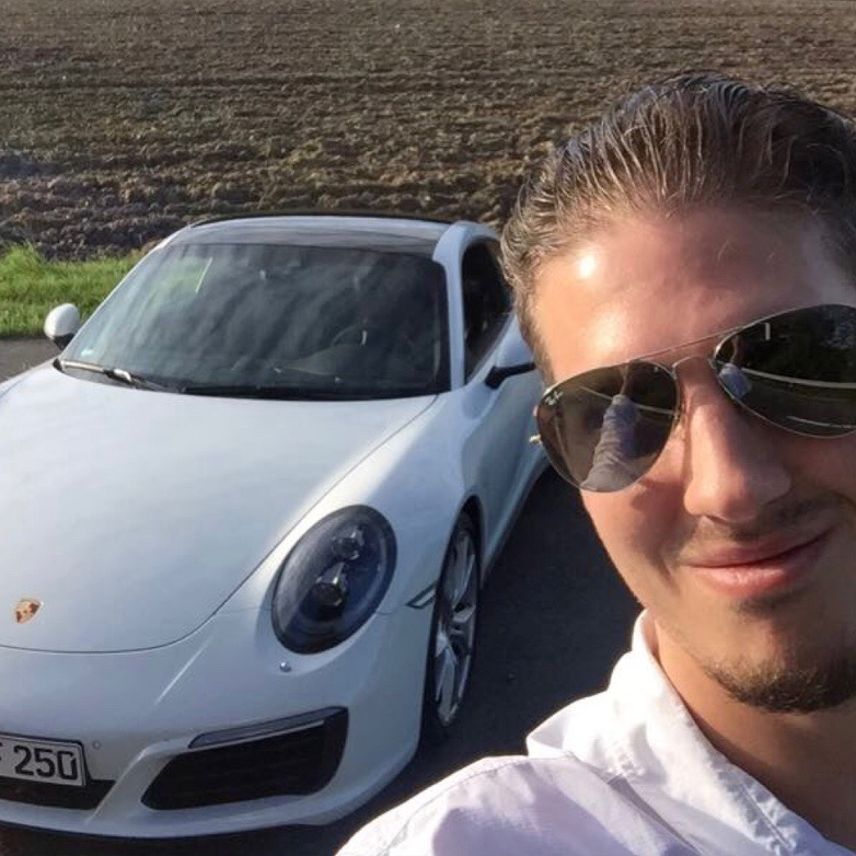 Jason taking a Porsche for a drive in Germany, courtesy of a former perk when flying Lufthansa First Class