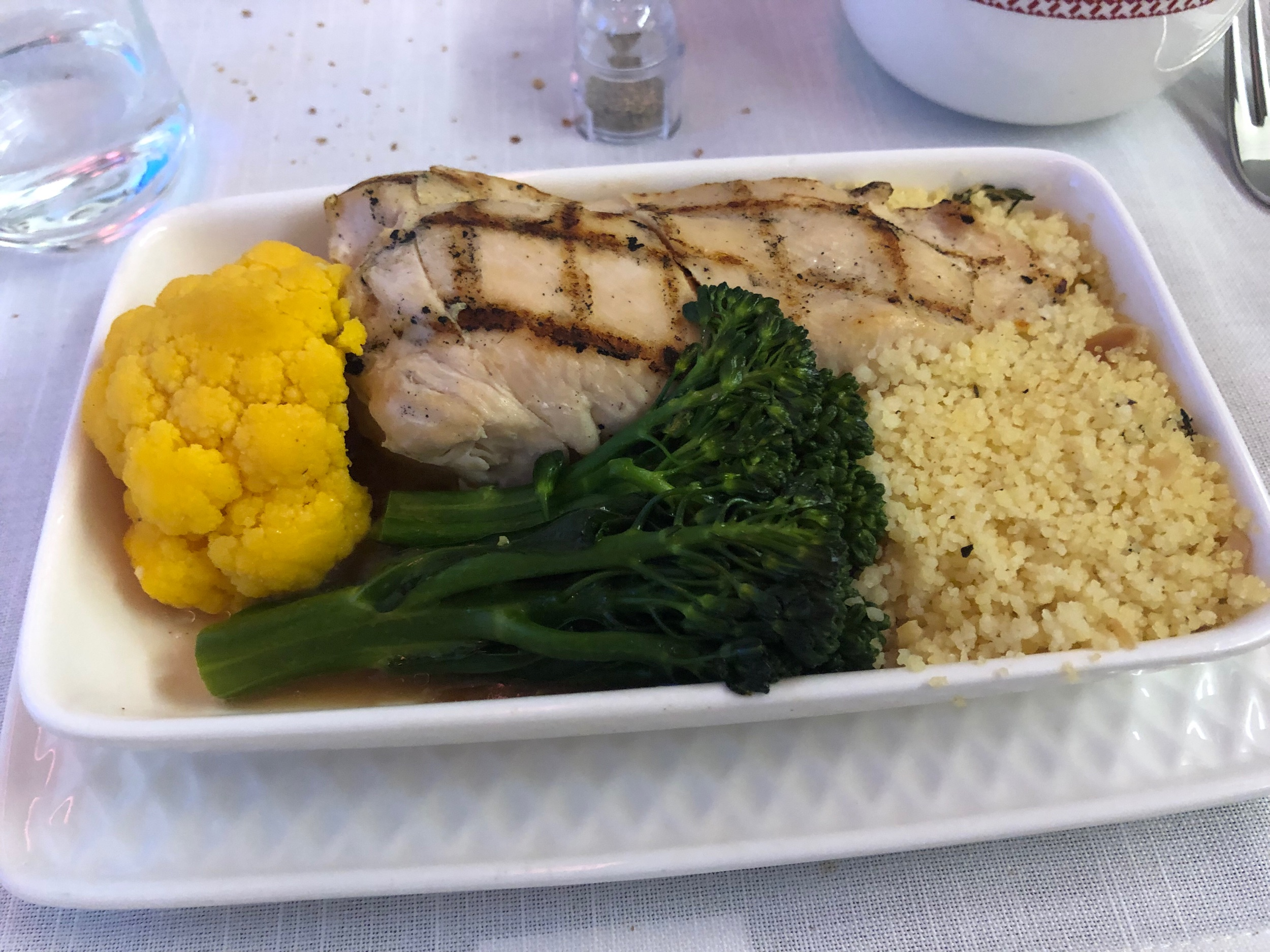 """My selection from Iberia's """"main course"""": grilled chicken with demi glace sauce, couscous, yellow cauliflower and broccolini"""