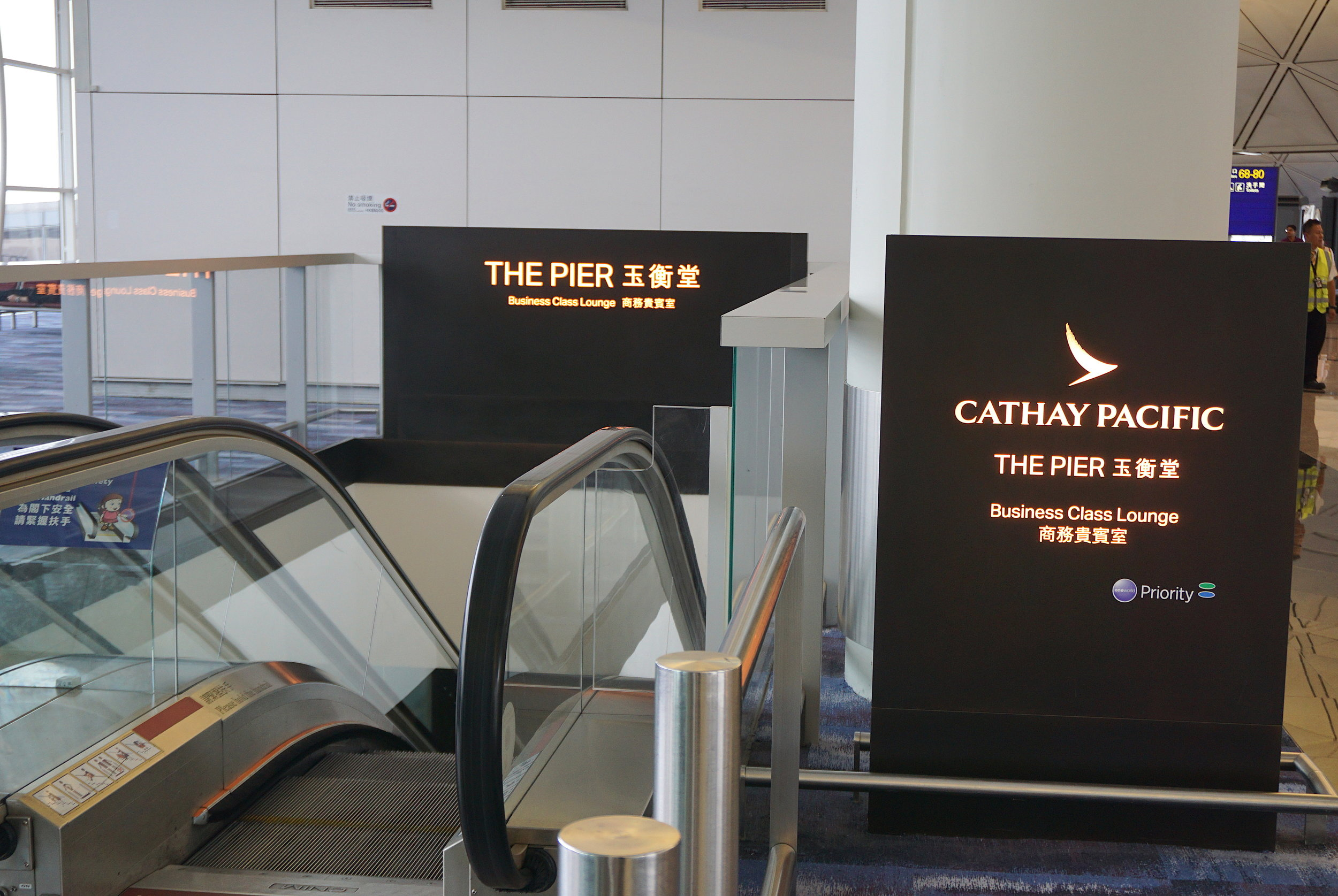 Cathay Pacific's Pier Business Class Lounge can be accessed by this set of escalators