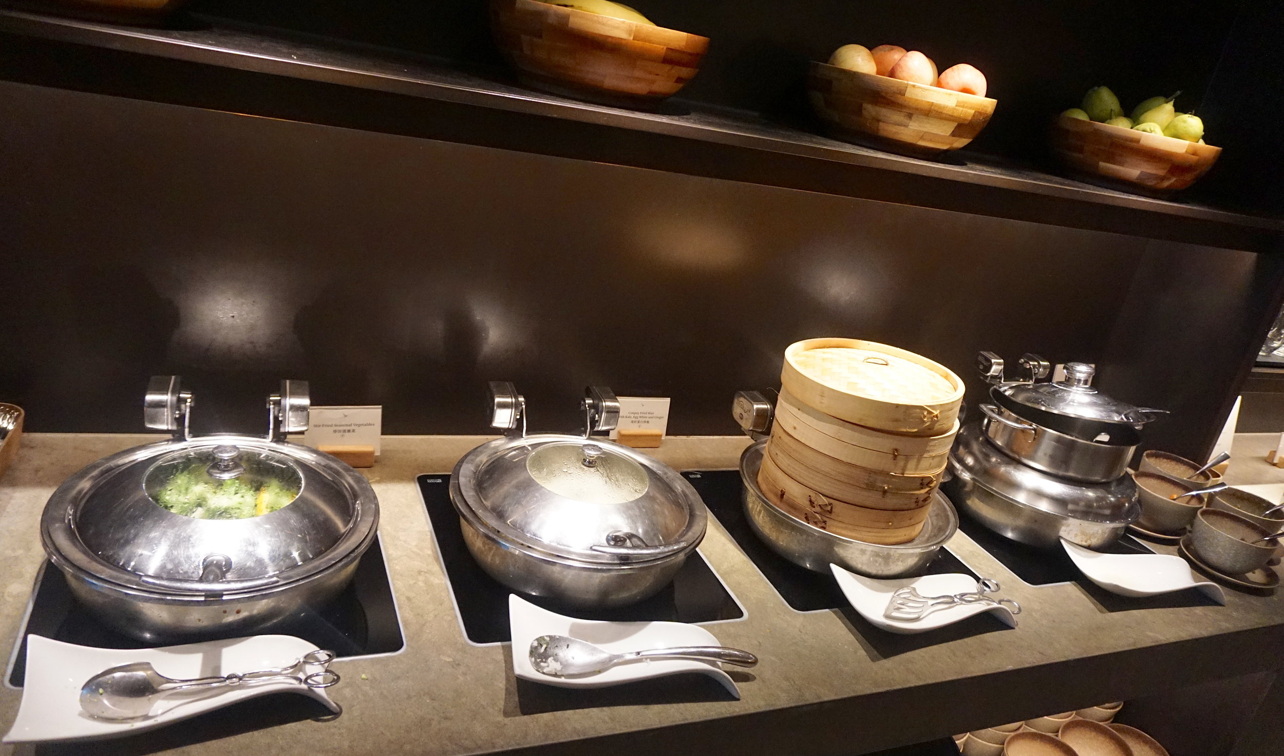 Hot dishes including rice, dim sum, congee and vegetables