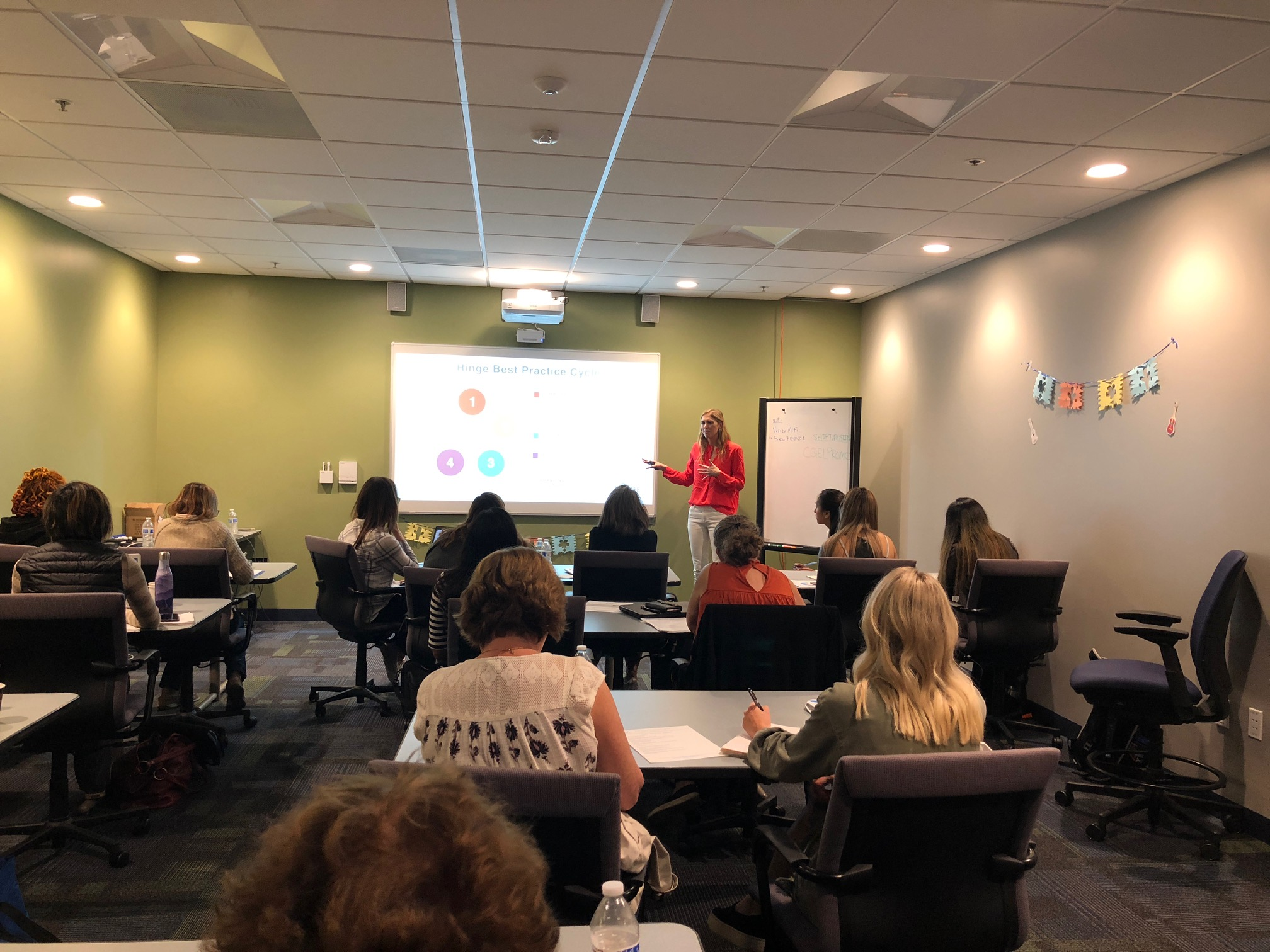 Molly sharing her marketing insights at a workshop for CQEL members.