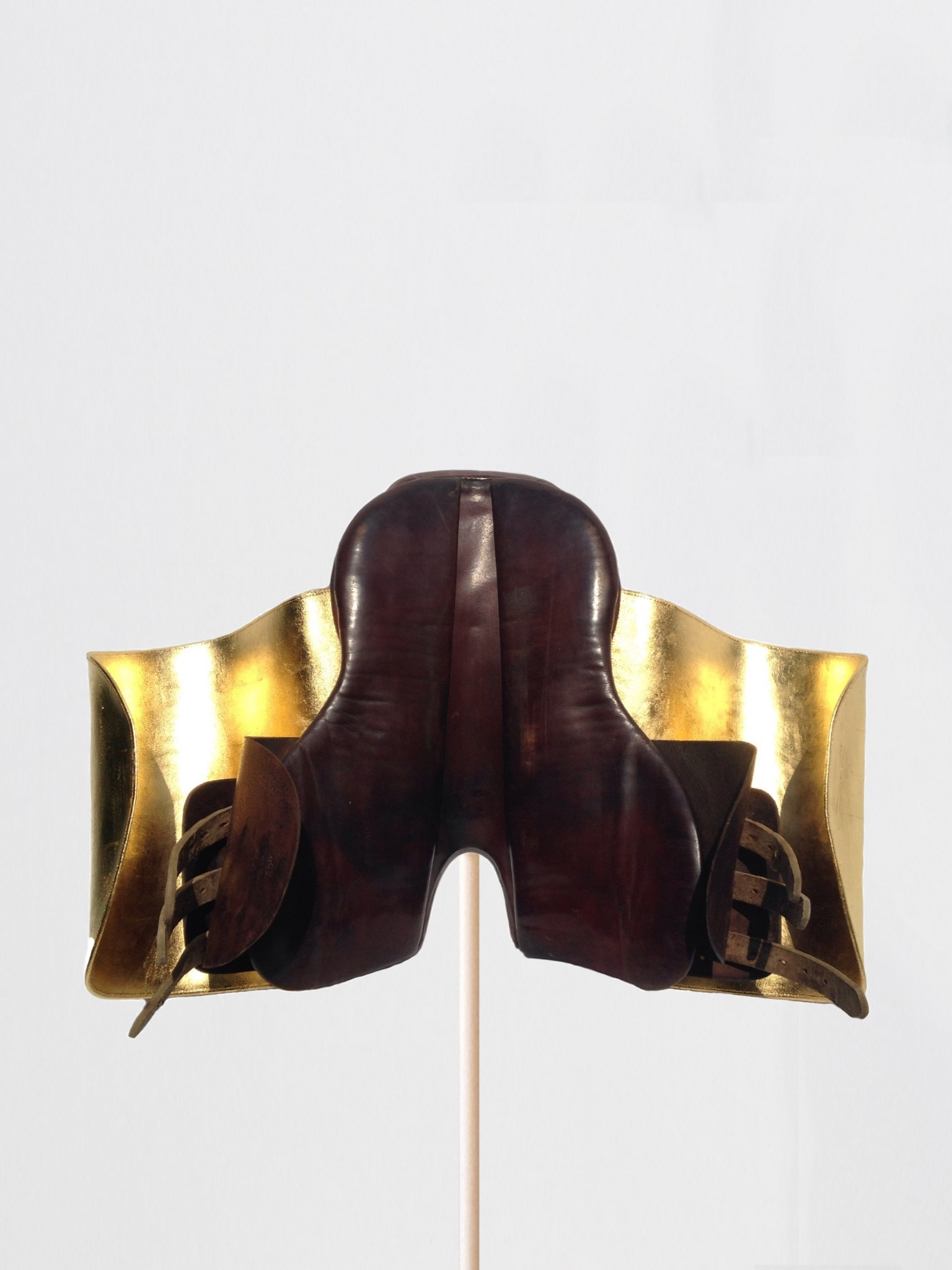Passages (#06),  2016 Leather horse saddles, 24k gold leaf 18 x 25 x 18 inches