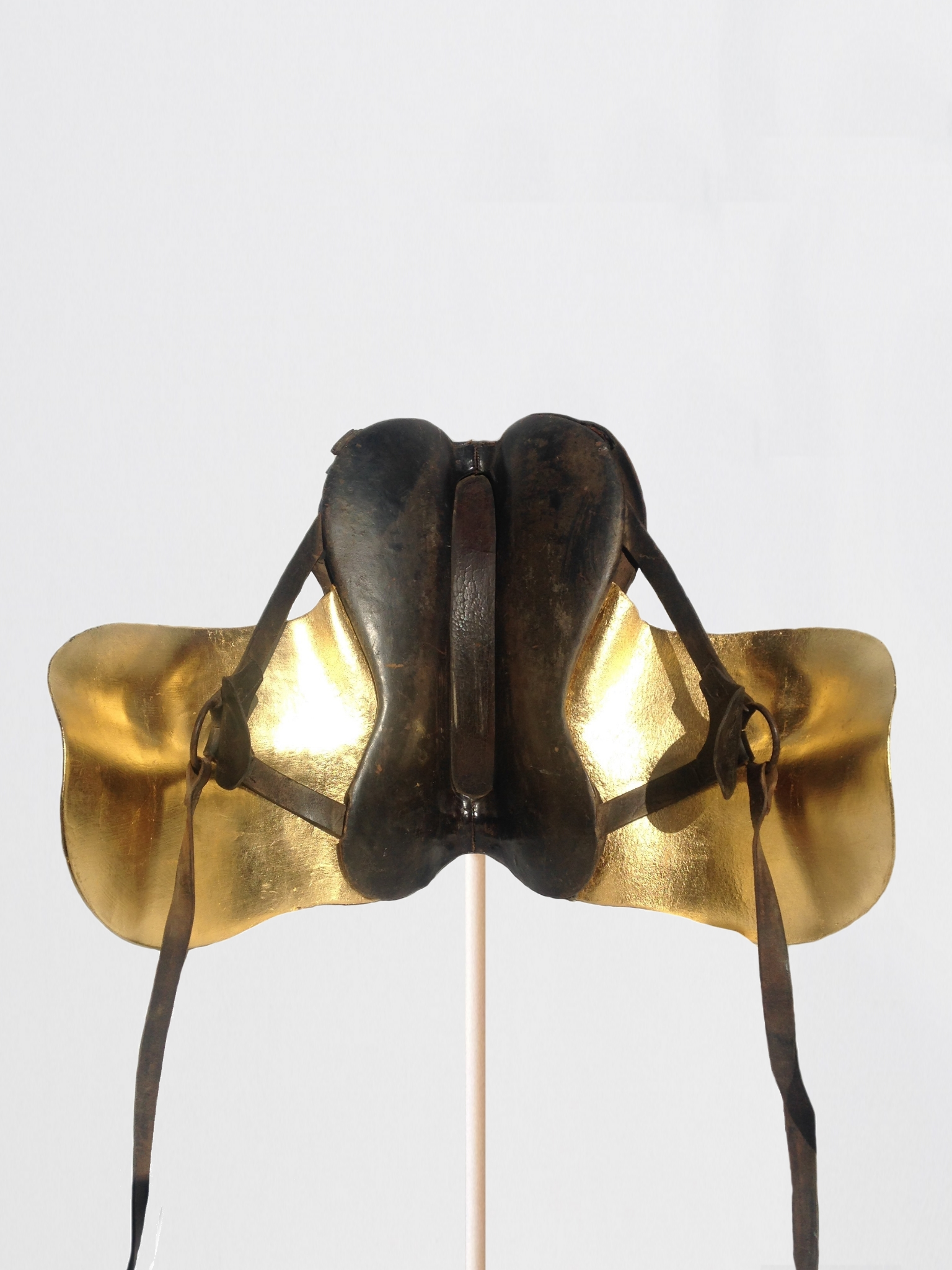 Passages (#09),  2016 Leather horse saddles, 24k gold leaf 18 x 28 x 21 inches