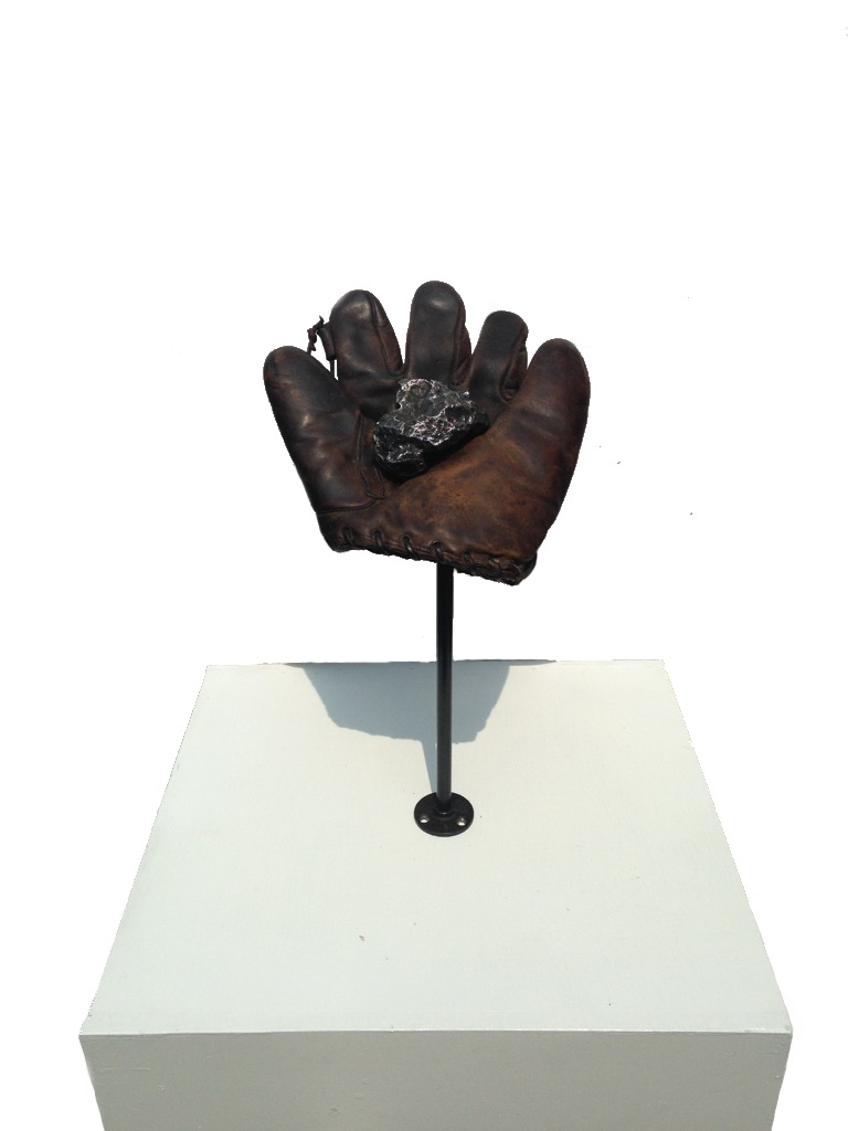 Interval,  2014 Meteorite, leather baseball glove. 11 x 11 x 8 inches