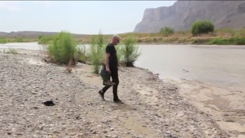 State of Suspension  Digital video (still) Duration 4:53 min.  A video chronicling the crossing of the Rio Grande River adds another level of narrative to the sculptural portion of the work.