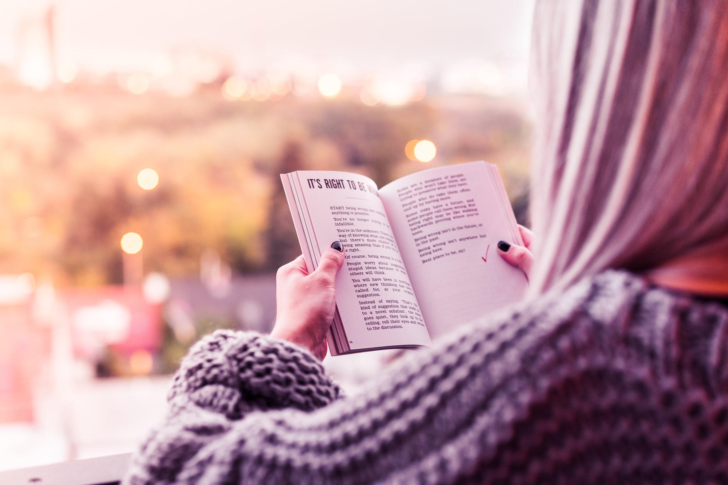 young-woman-reading-a-book-on-terrace-picjumbo-com.jpg