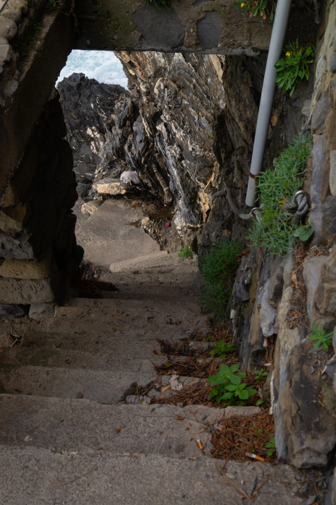 Totally doable…without a knee injury. Concrete water stairs in Manarola, Italy.