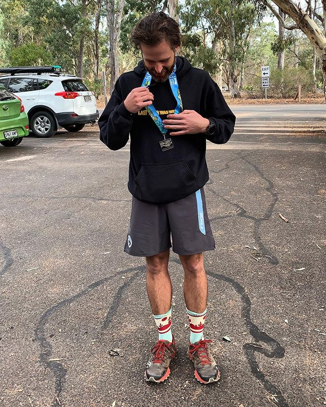 """Ran 58km today, got a medal.  Mum took a photo of me doing that """"candid look down slightly laugh and blink to show your eyeshadow"""" pose all the hot girls do #thotlife"""